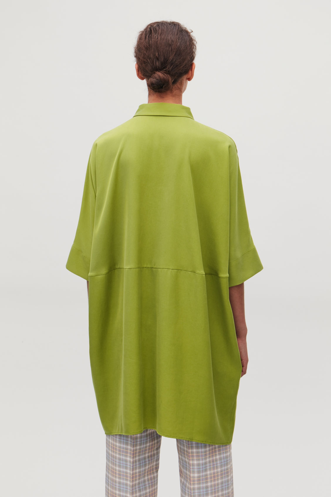 Model side image of Cos draped boxy shirt dress in green