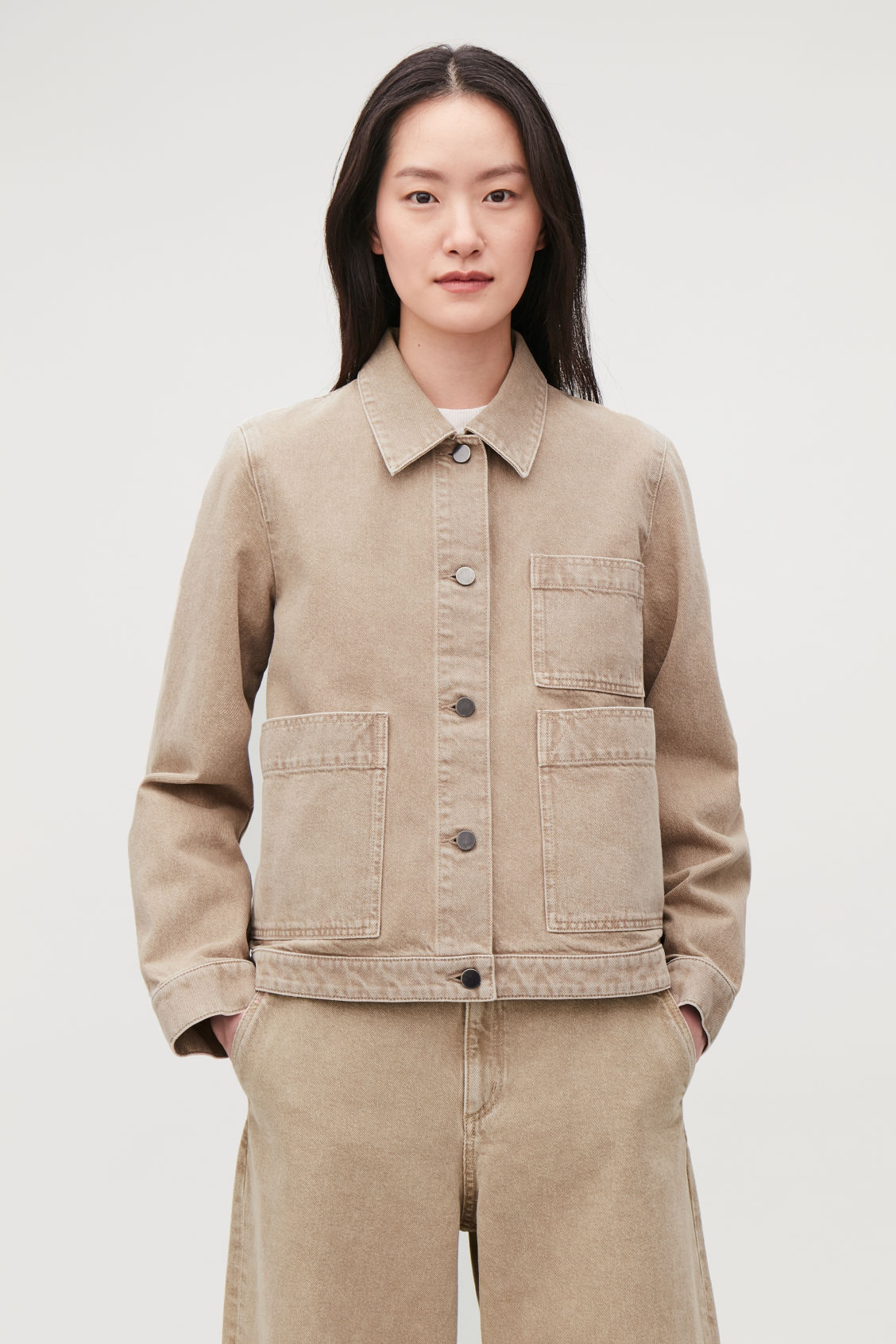 Model side image of Cos denim jacket with patch pockets in beige