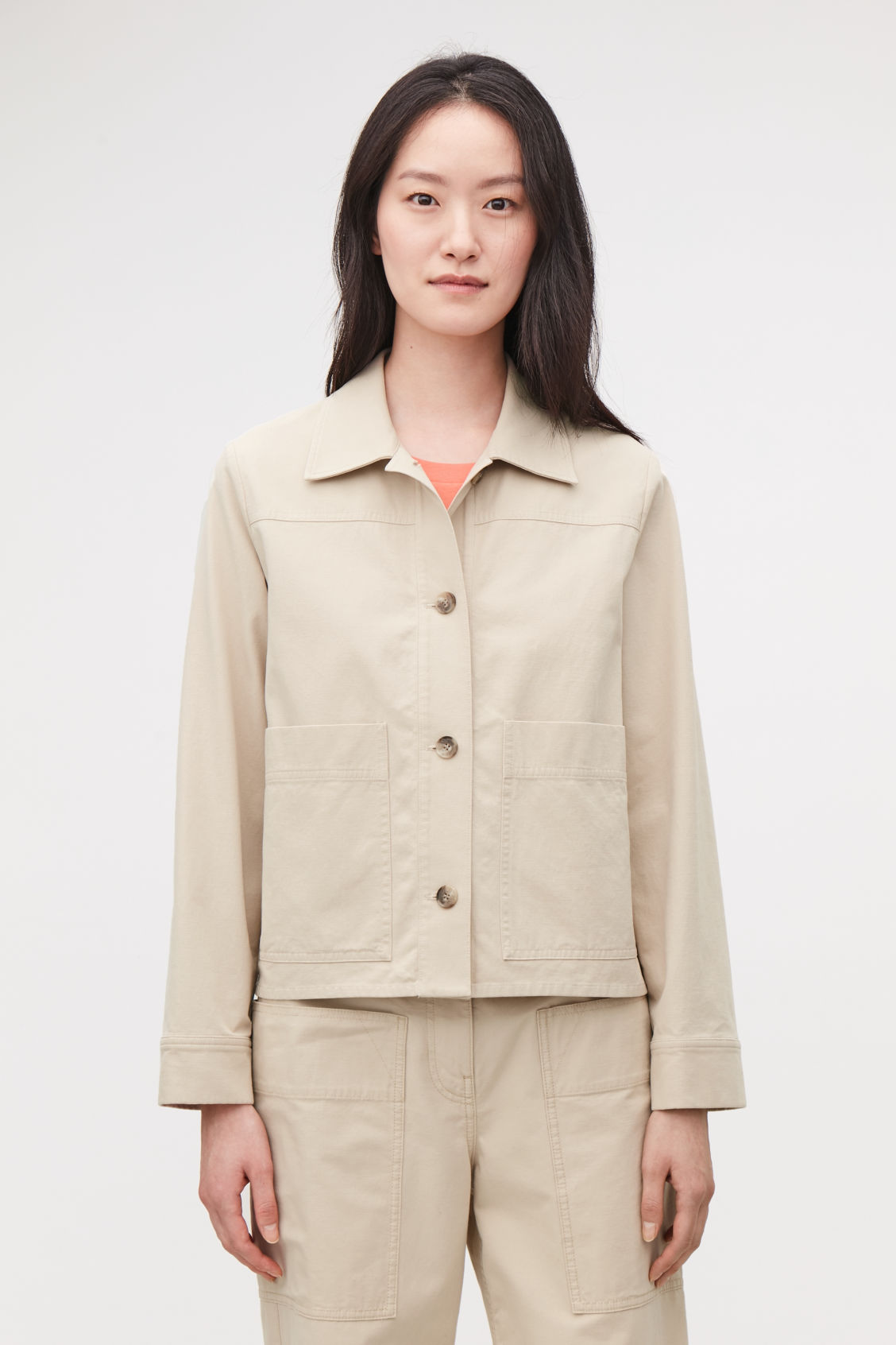 Model side image of Cos button-up canvas jacket in beige