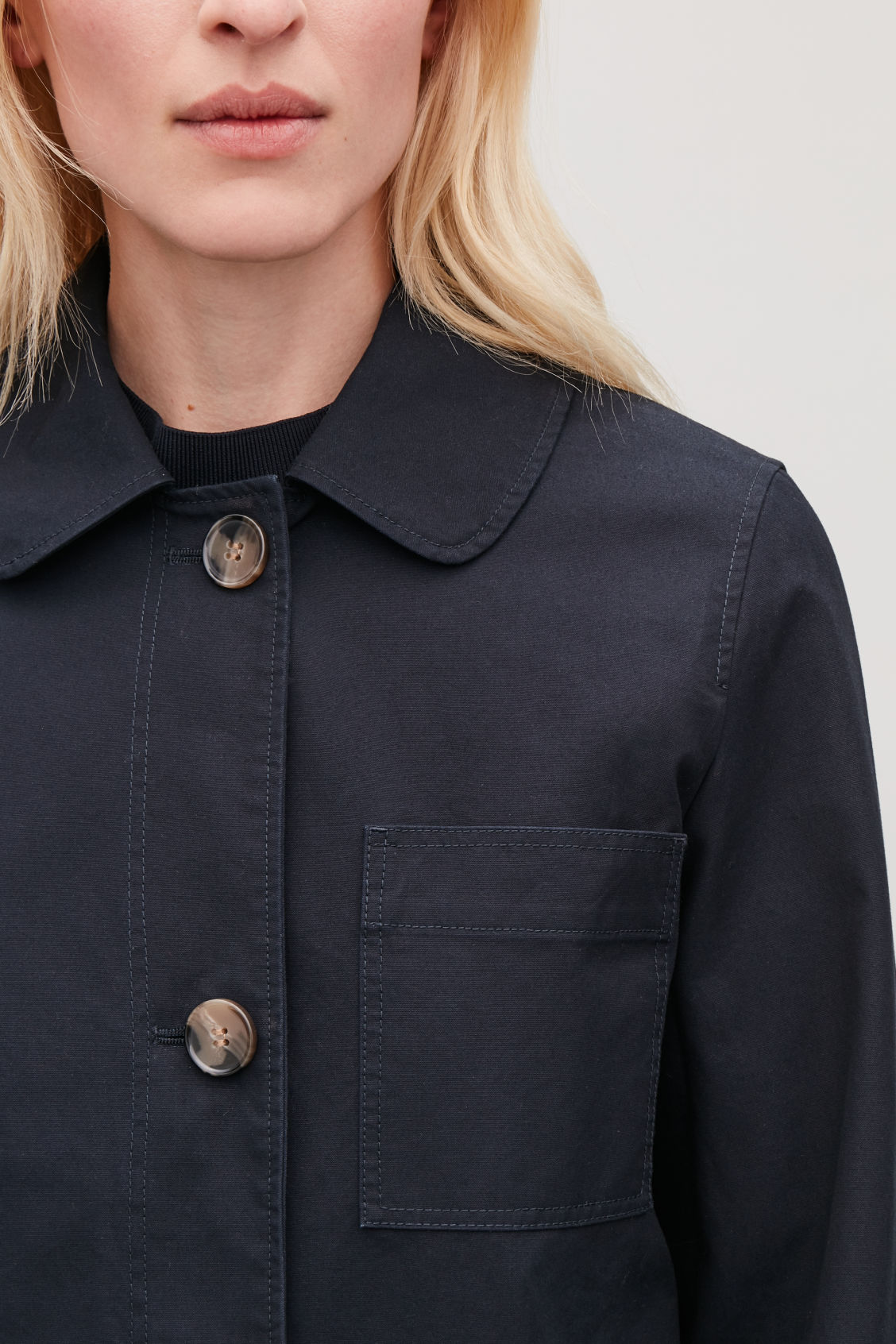 Model side image of Cos short workwear trench coat in blue