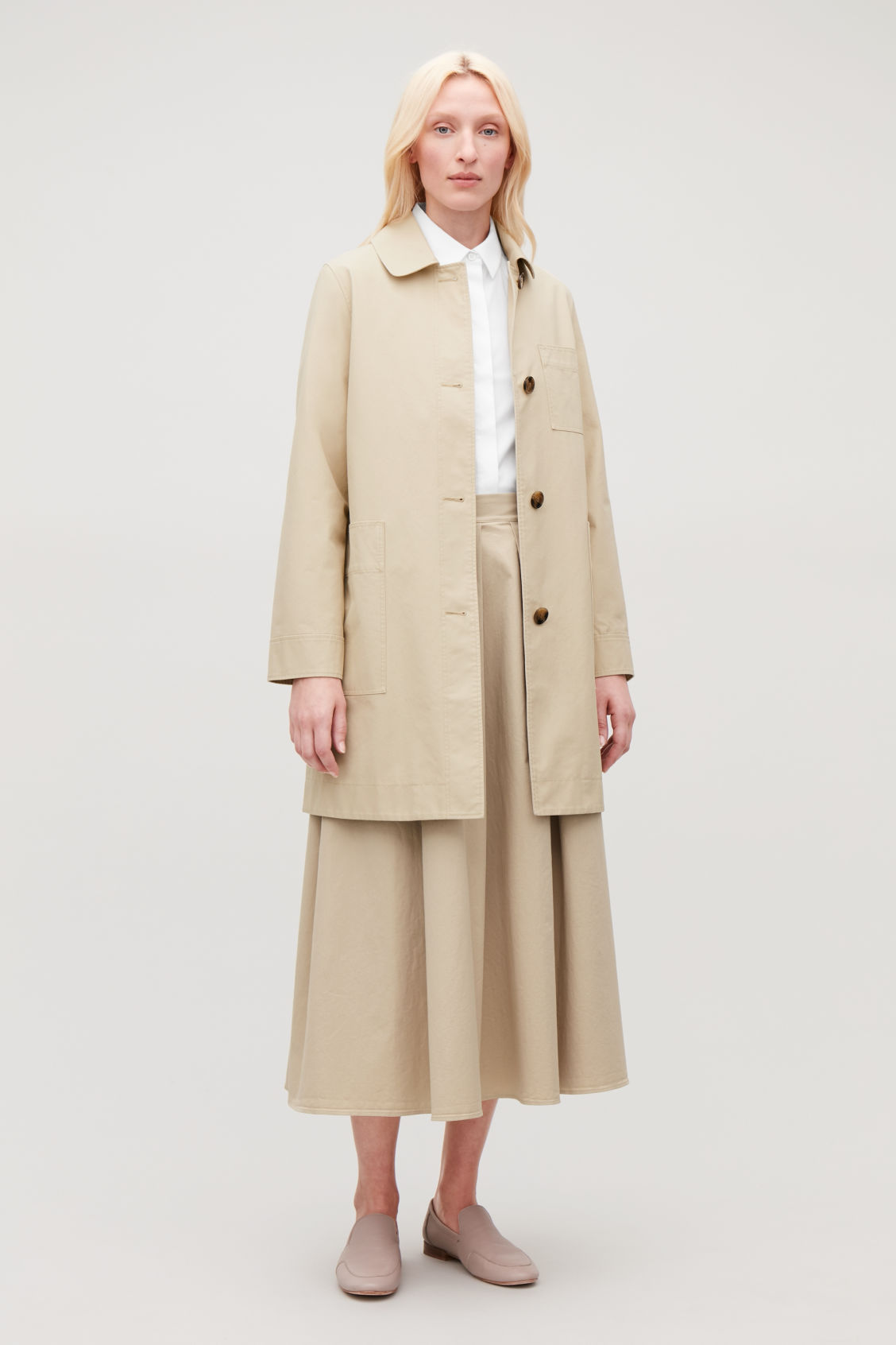 Model front image of Cos short workwear trench coat in beige