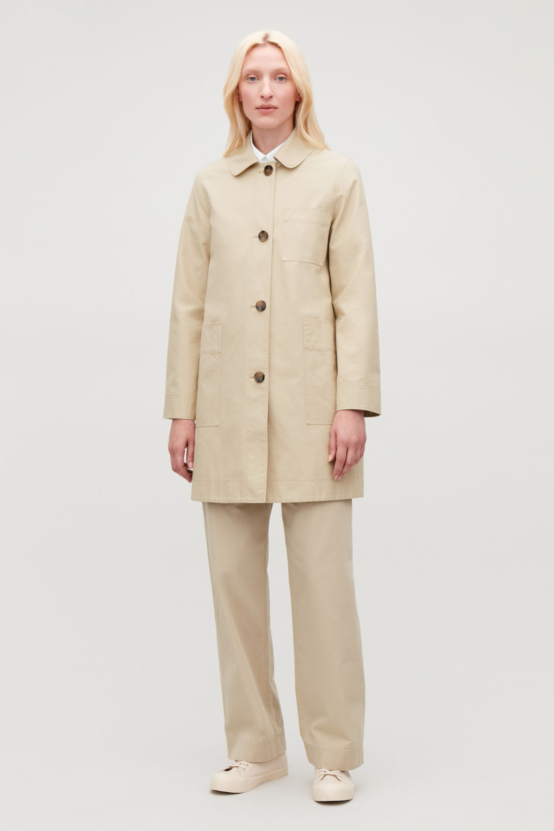 Model side image of Cos short workwear trench coat in beige