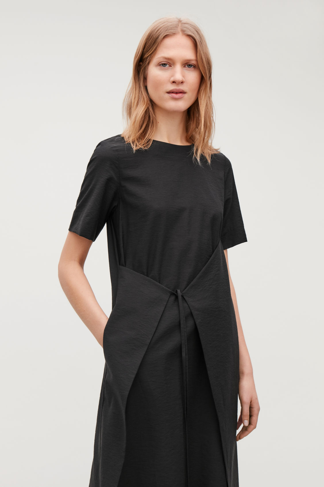 Model side image of Cos asymmetric tie dress  in black