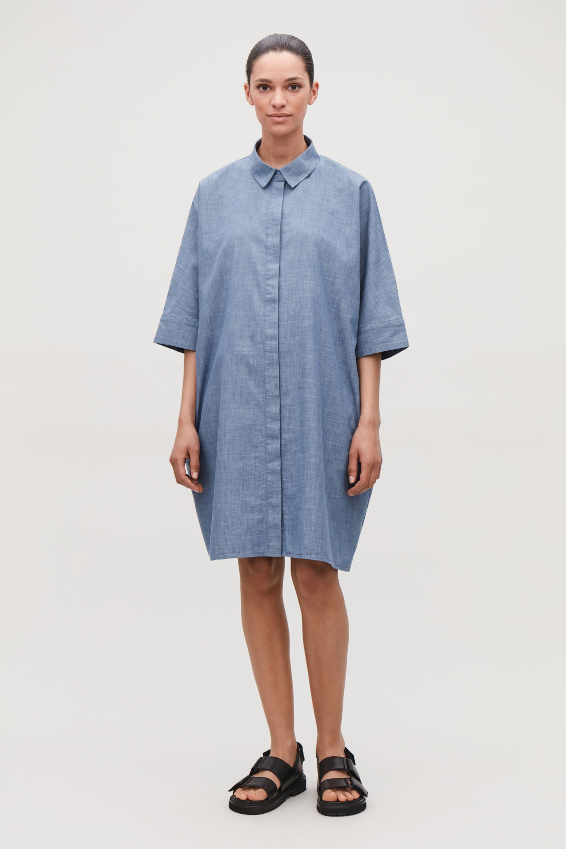 7ac6b1eb3ce Model front image of Cos boxy denim shirt dress in blue