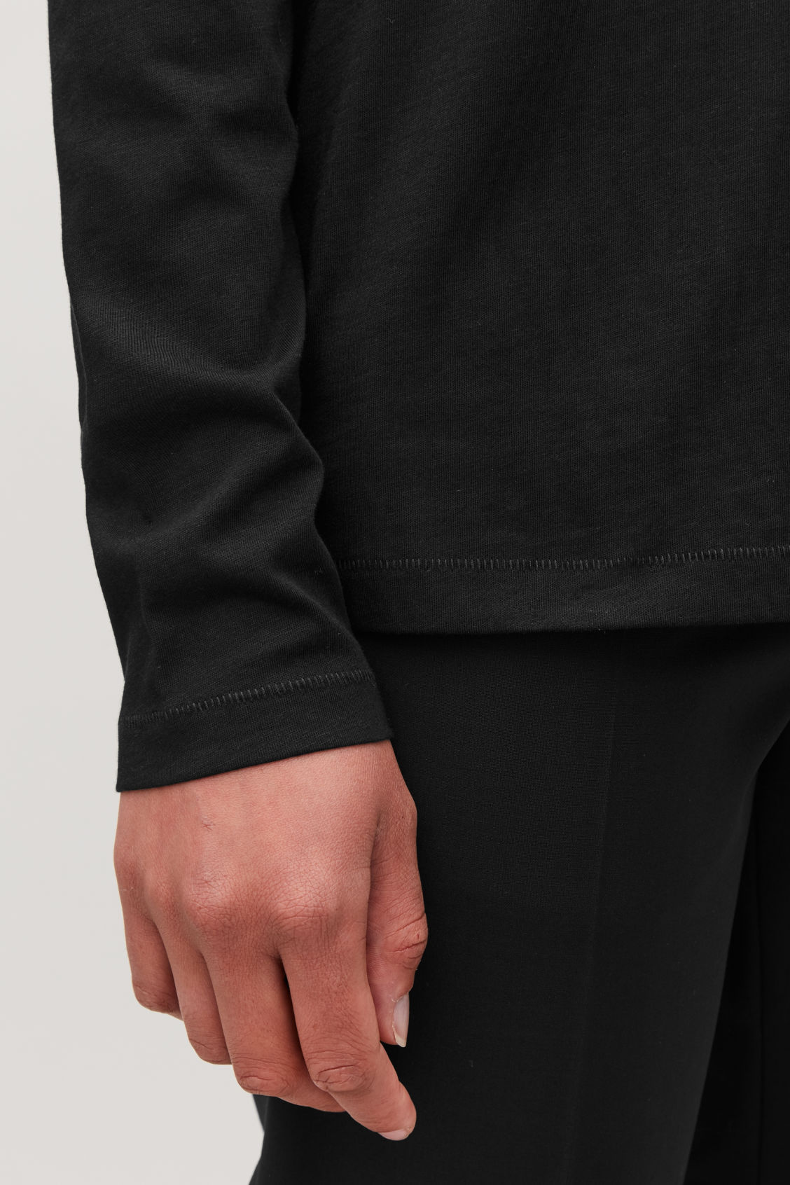 Model side image of Cos straight-hem long-sleeved top in black