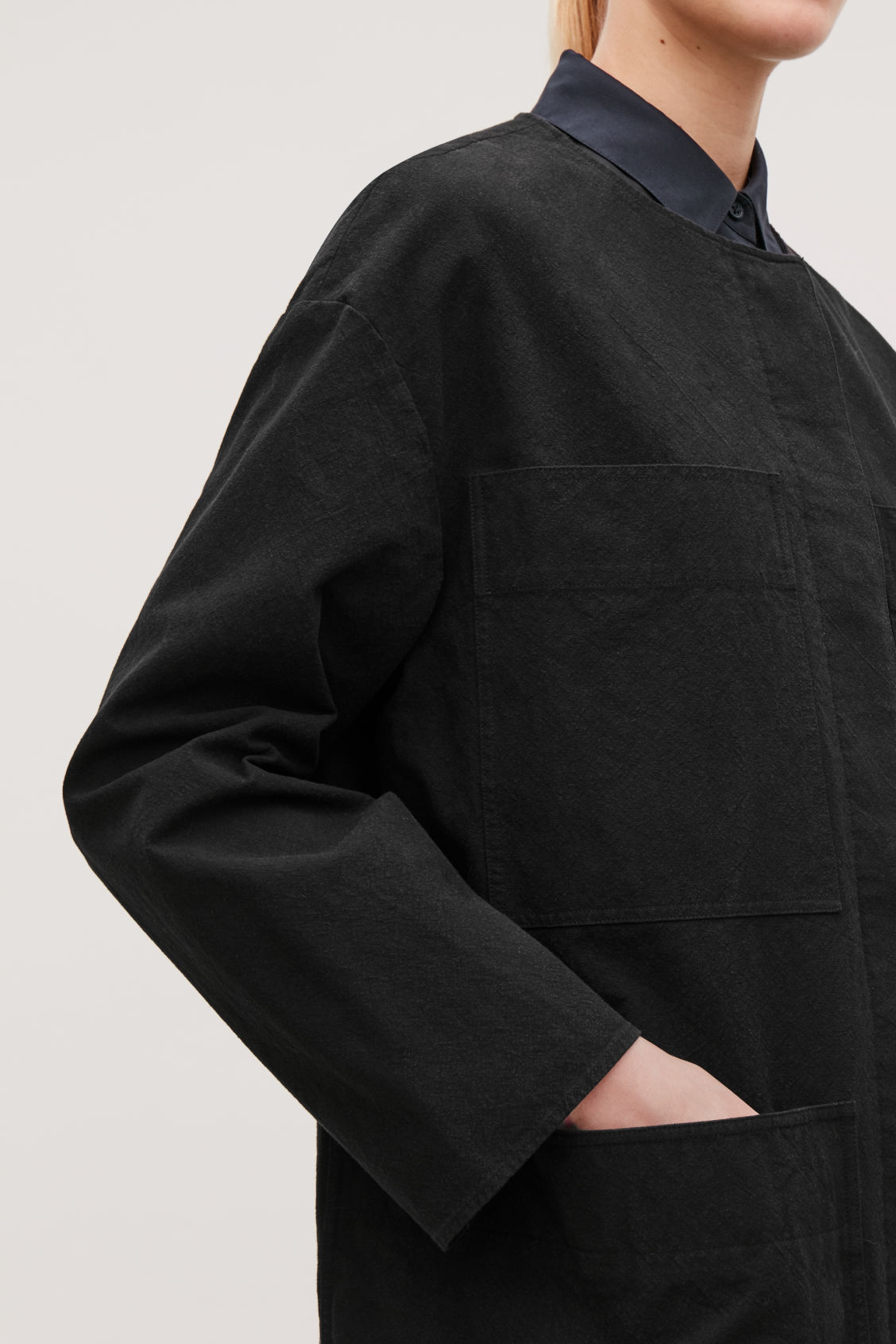 Model side image of Cos jacket with patch pockets in black