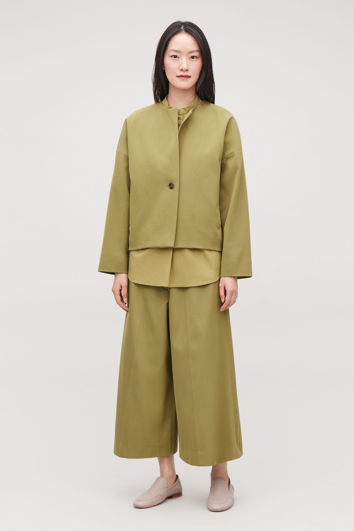 Model front image of Cos boxy a-line cotton jacket in green