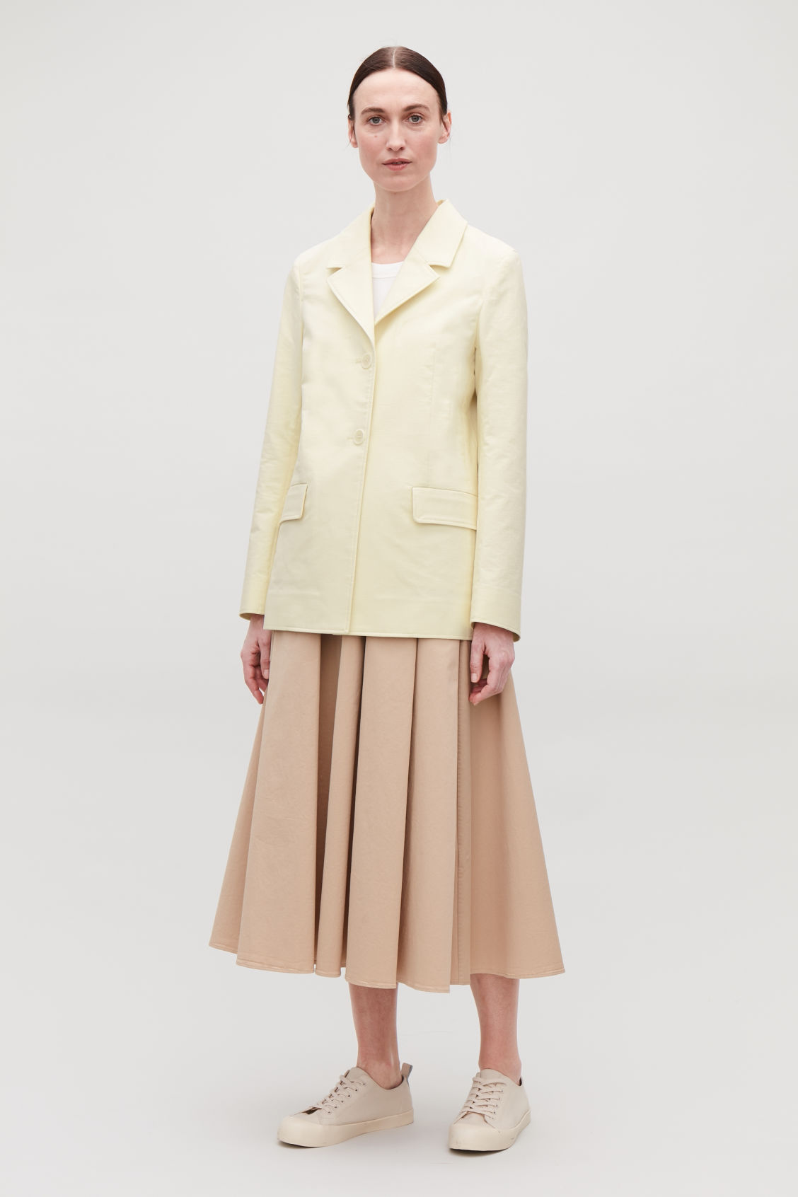 Model front image of Cos relaxed cotton blazer in cream