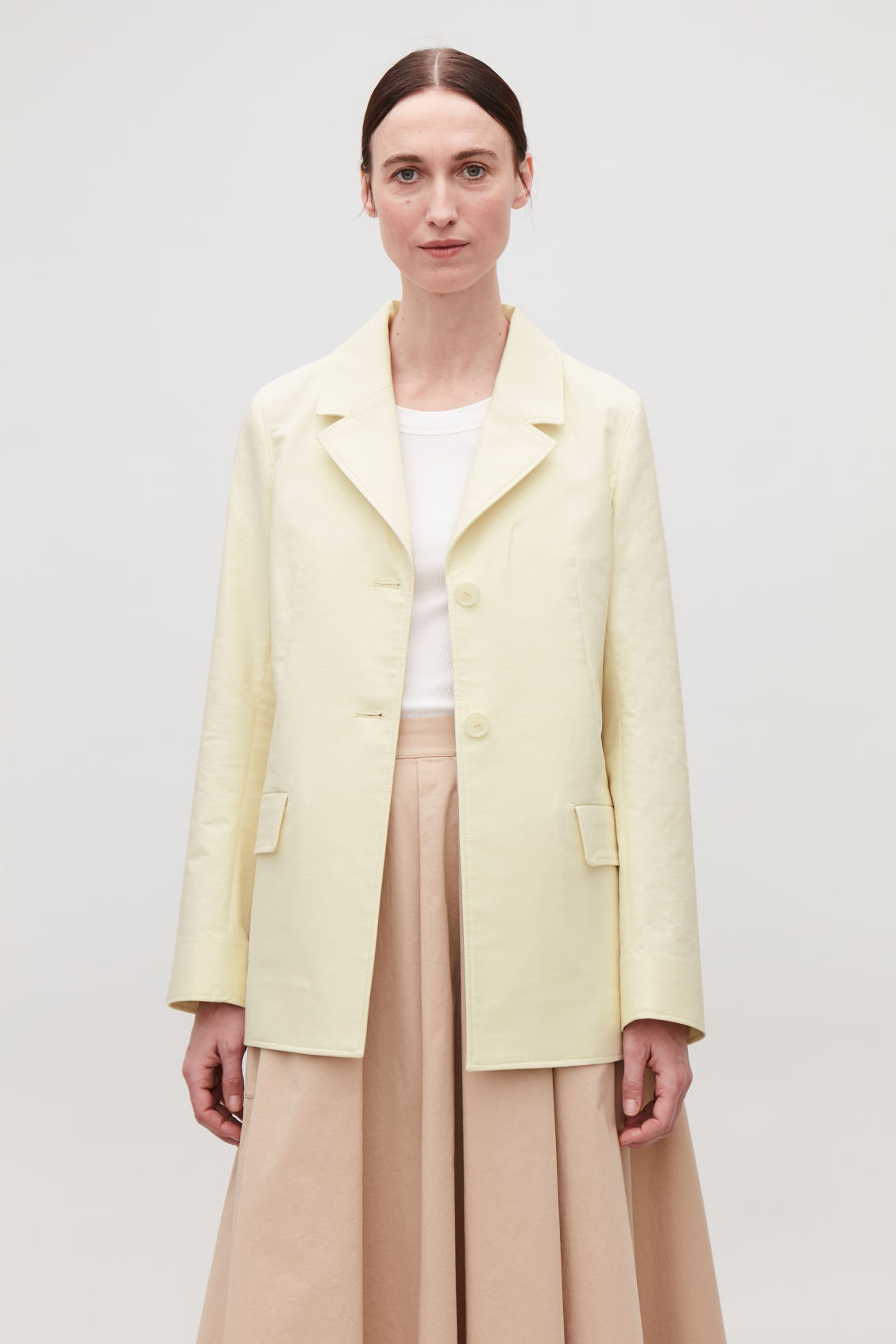 Model side image of Cos relaxed cotton blazer in cream