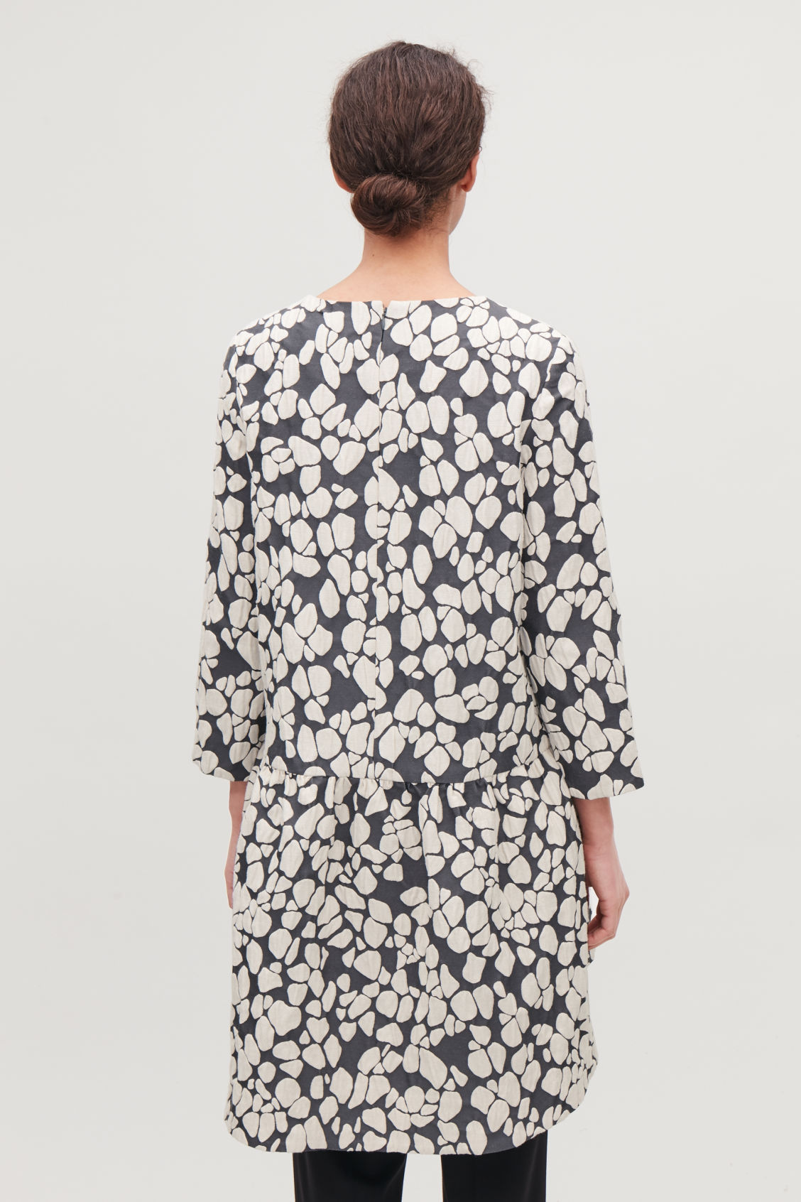 Model side image of Cos gathered jacquard a-line dress in grey