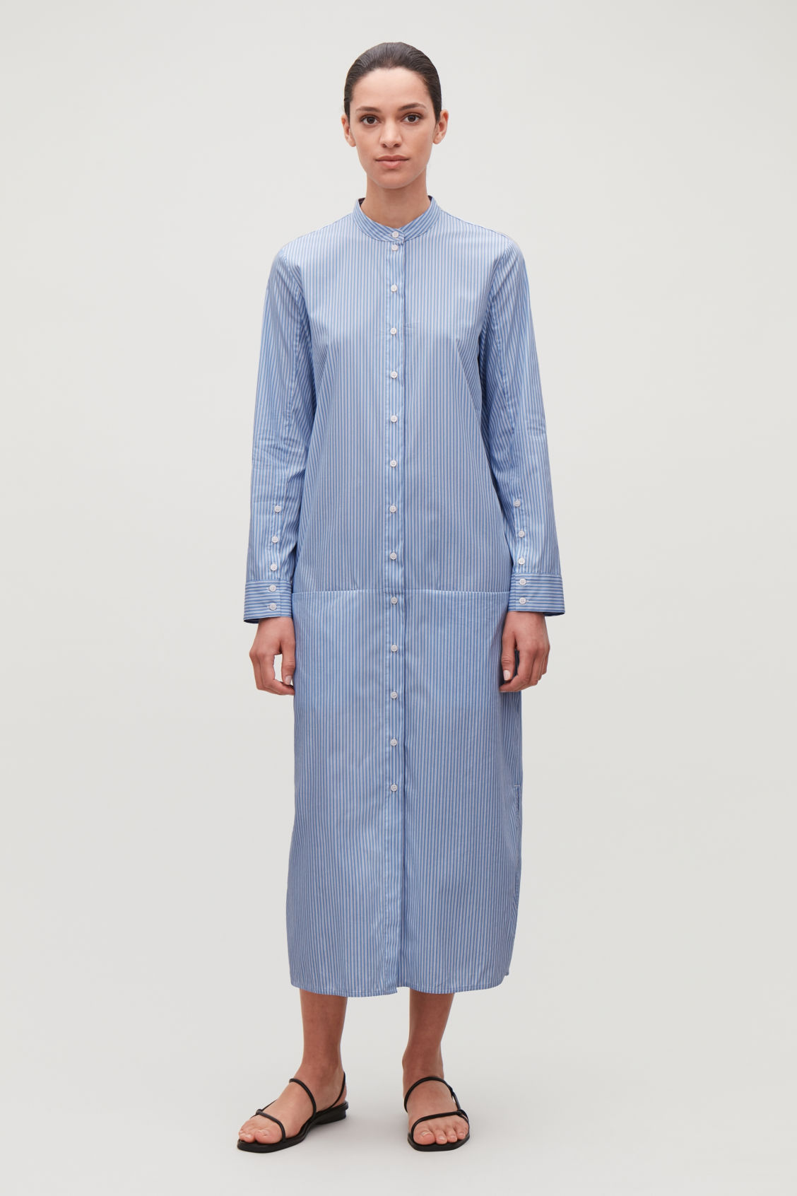 Model front image of Cos long striped cotton shirt in blue