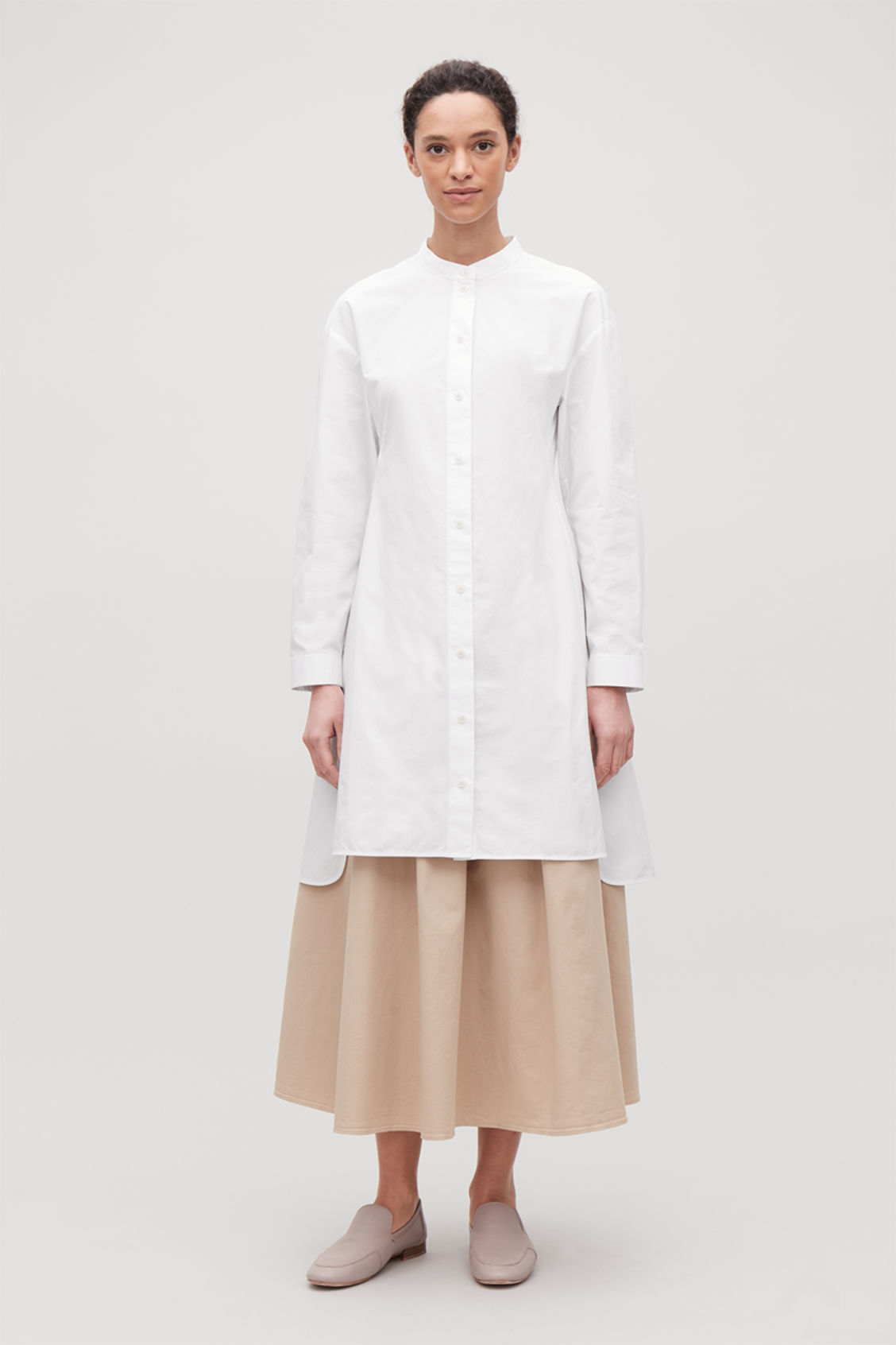 Model side image of Cos long tunic dress in white