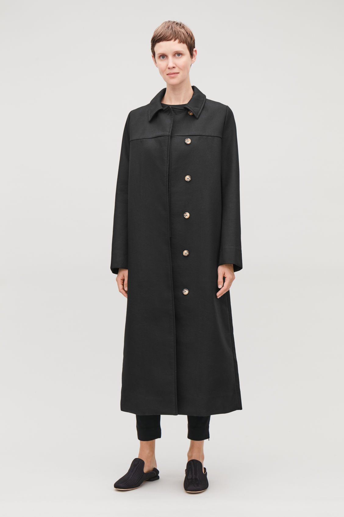 Model front image of Cos long textured-cotton coat  in black