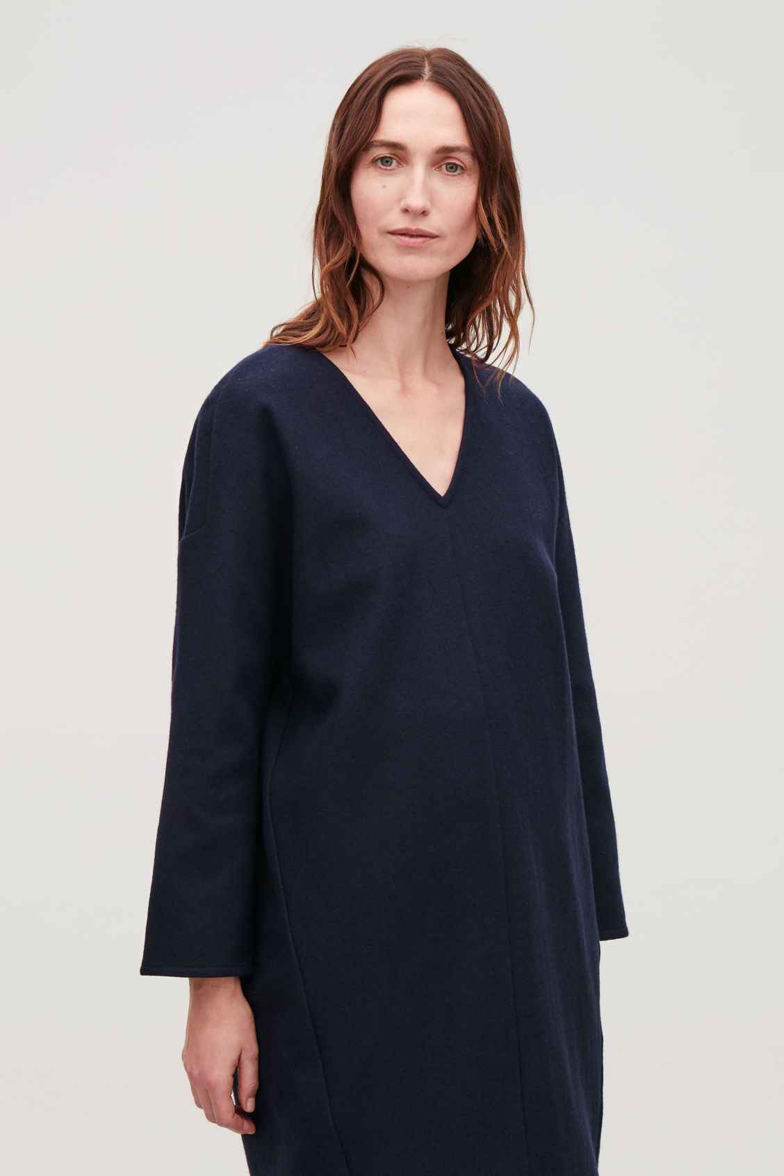 Model side image of Cos oversized wool v-neck dress in blue