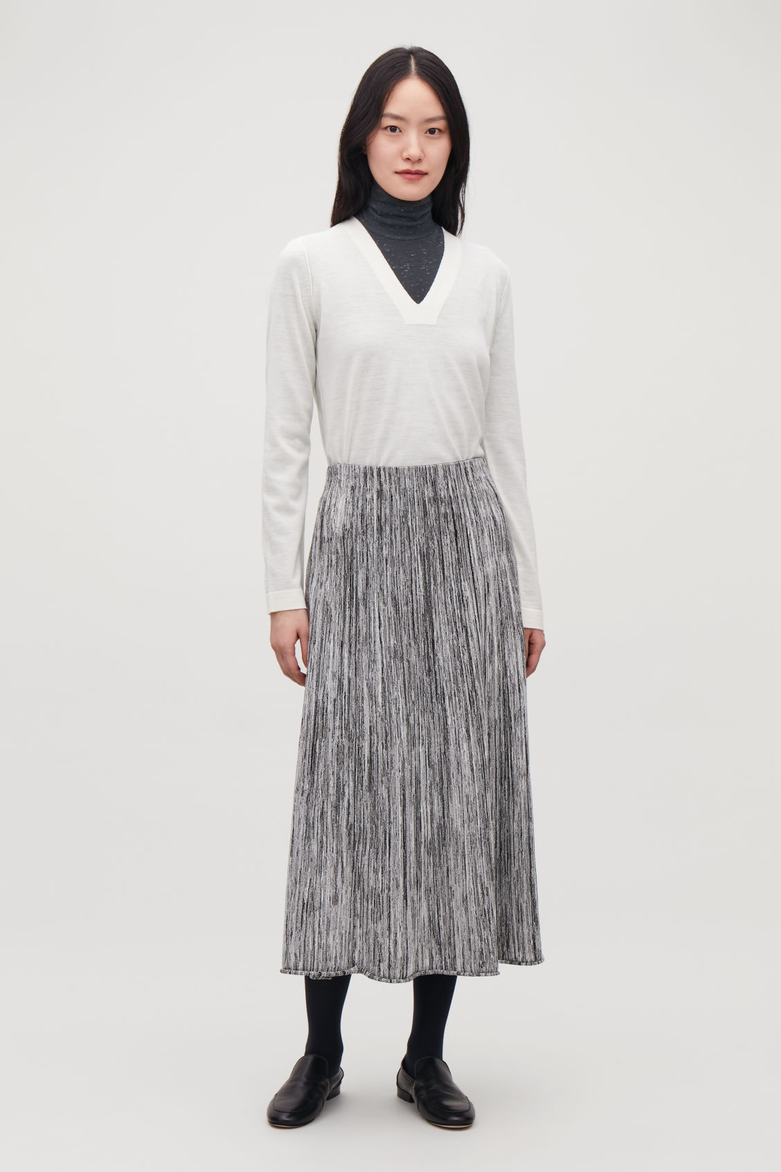 Model front image of Cos multi-quality a-line knit skirt  in black