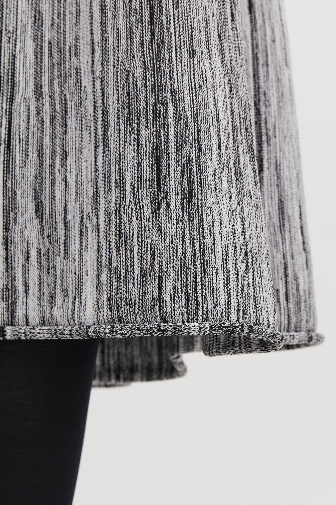 Model side image of Cos multi-quality a-line knit skirt  in black