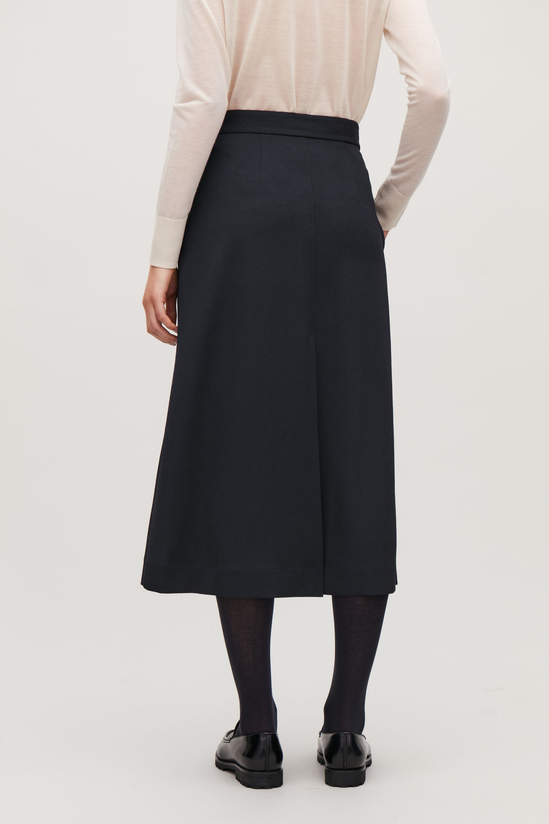 Model side image of Cos slit-detailed mid-length skirt in blue