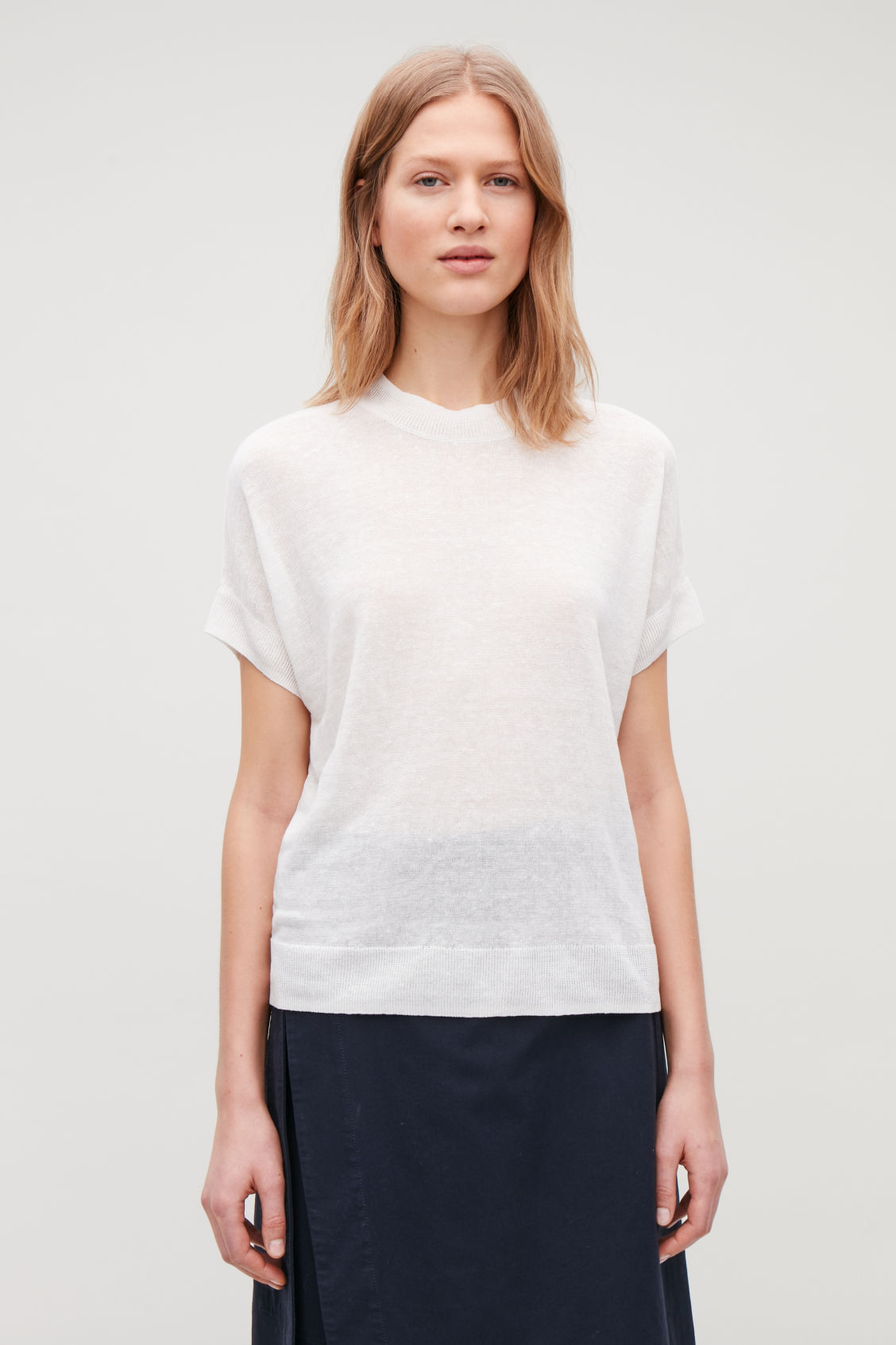 Model side image of Cos shaped linen-silk knit top in white