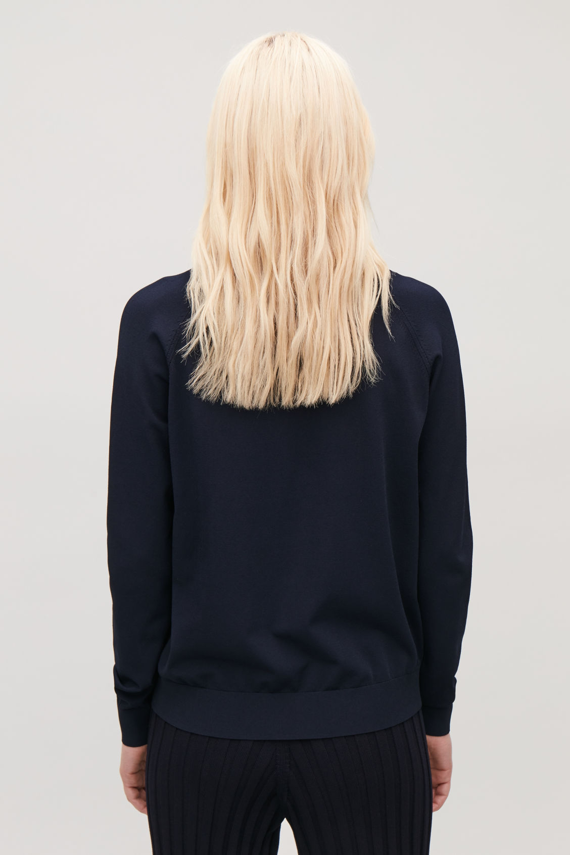 Model side image of Cos pointelle-detailed knitted top in blue