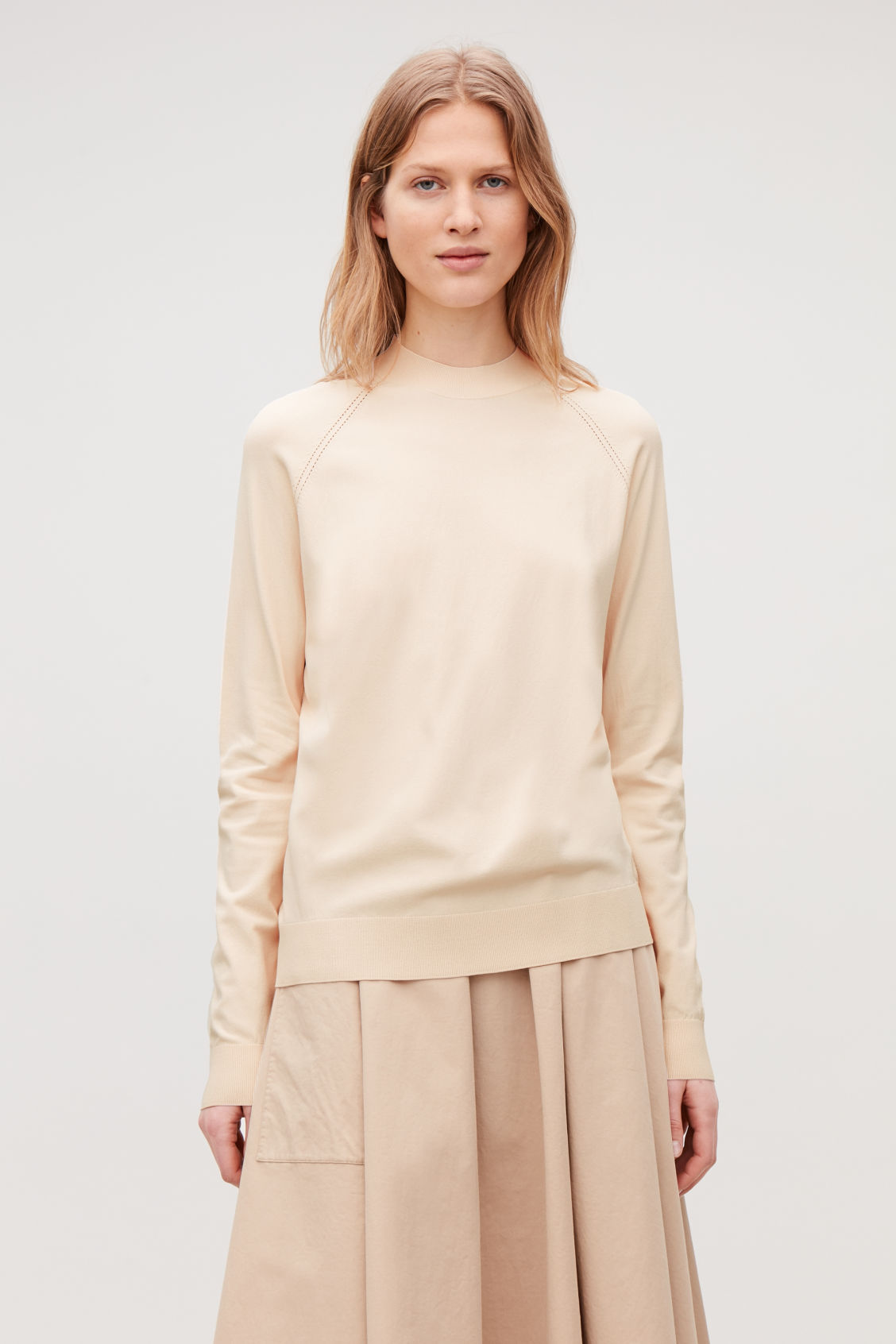 Model side image of Cos pointelle-detailed knitted top in beige