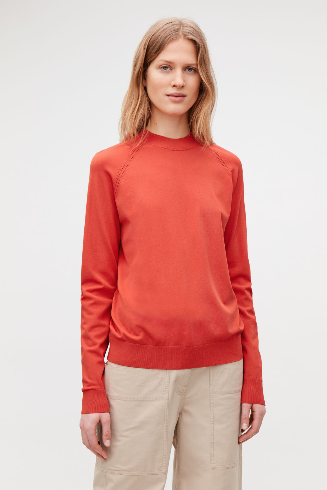 Model side image of Cos pointelle-detailed knitted top in orange