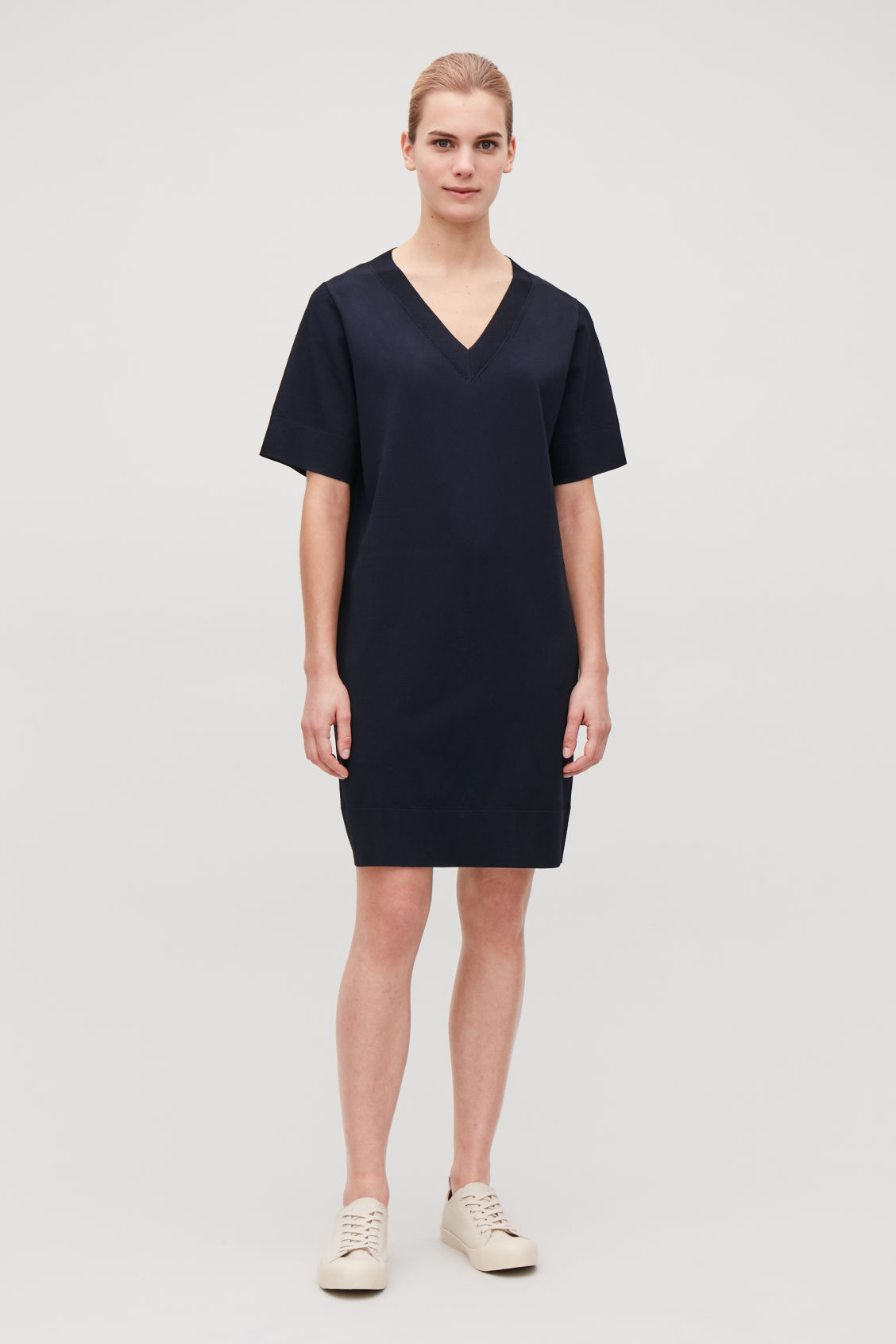Model front image of Cos straight v-neck knit dress  in blue