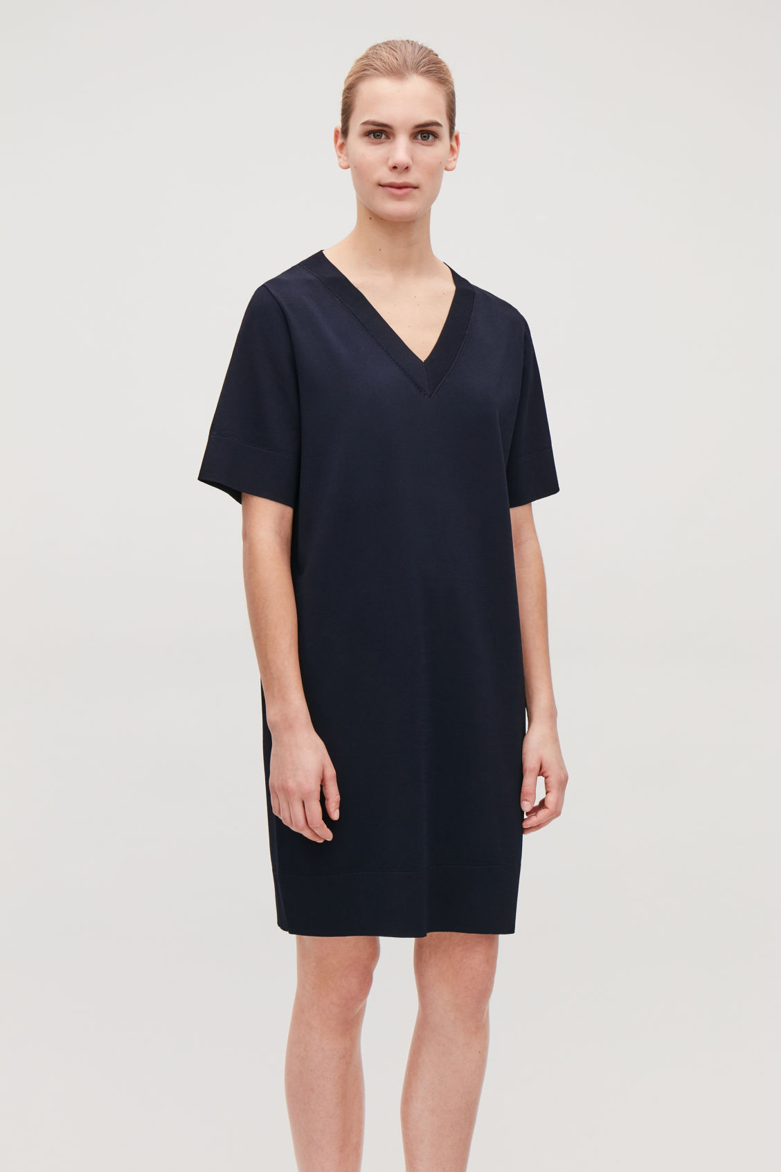 Model side image of Cos straight v-neck knit dress  in blue