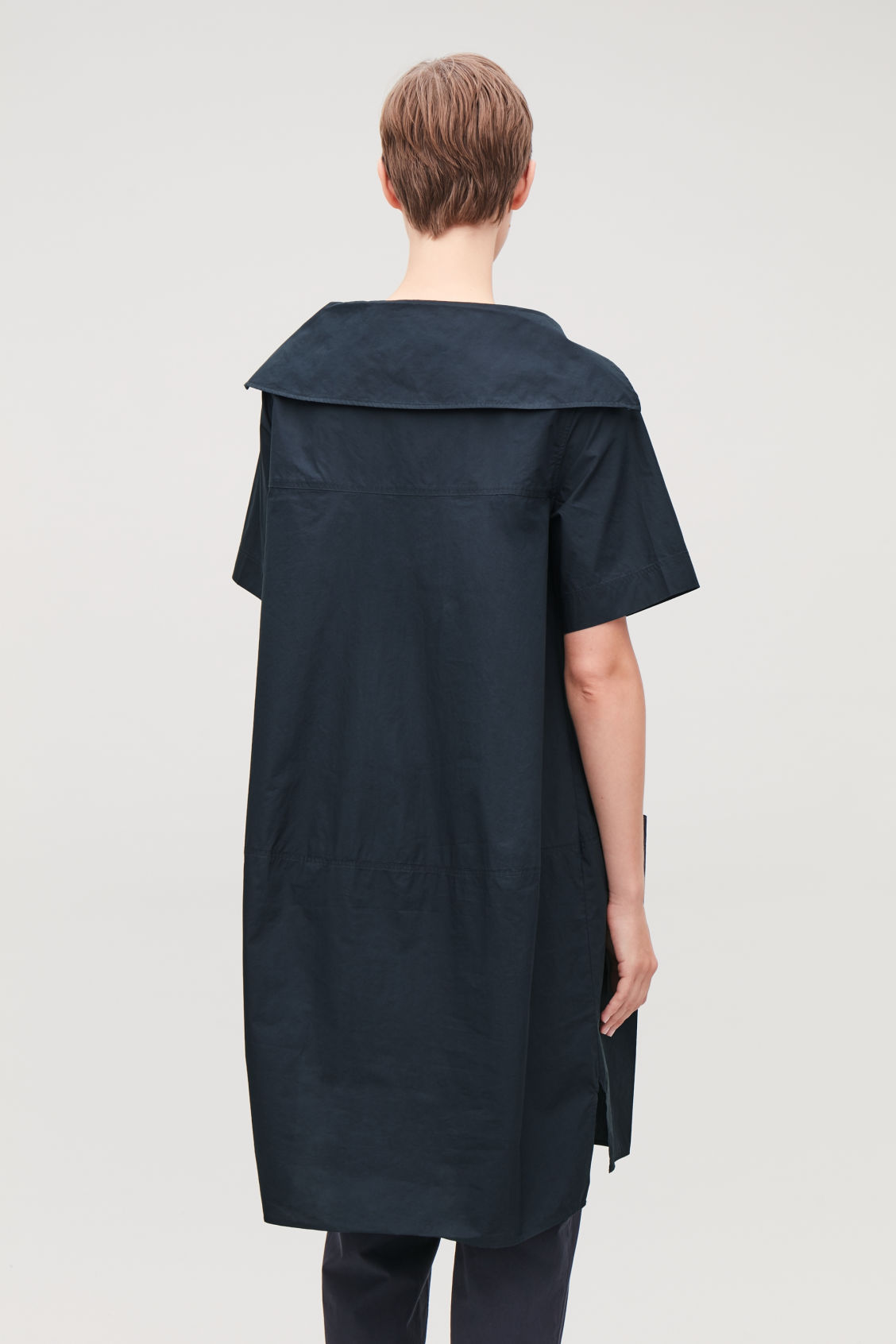 Model side image of Cos relaxed sailor-neck dress in blue