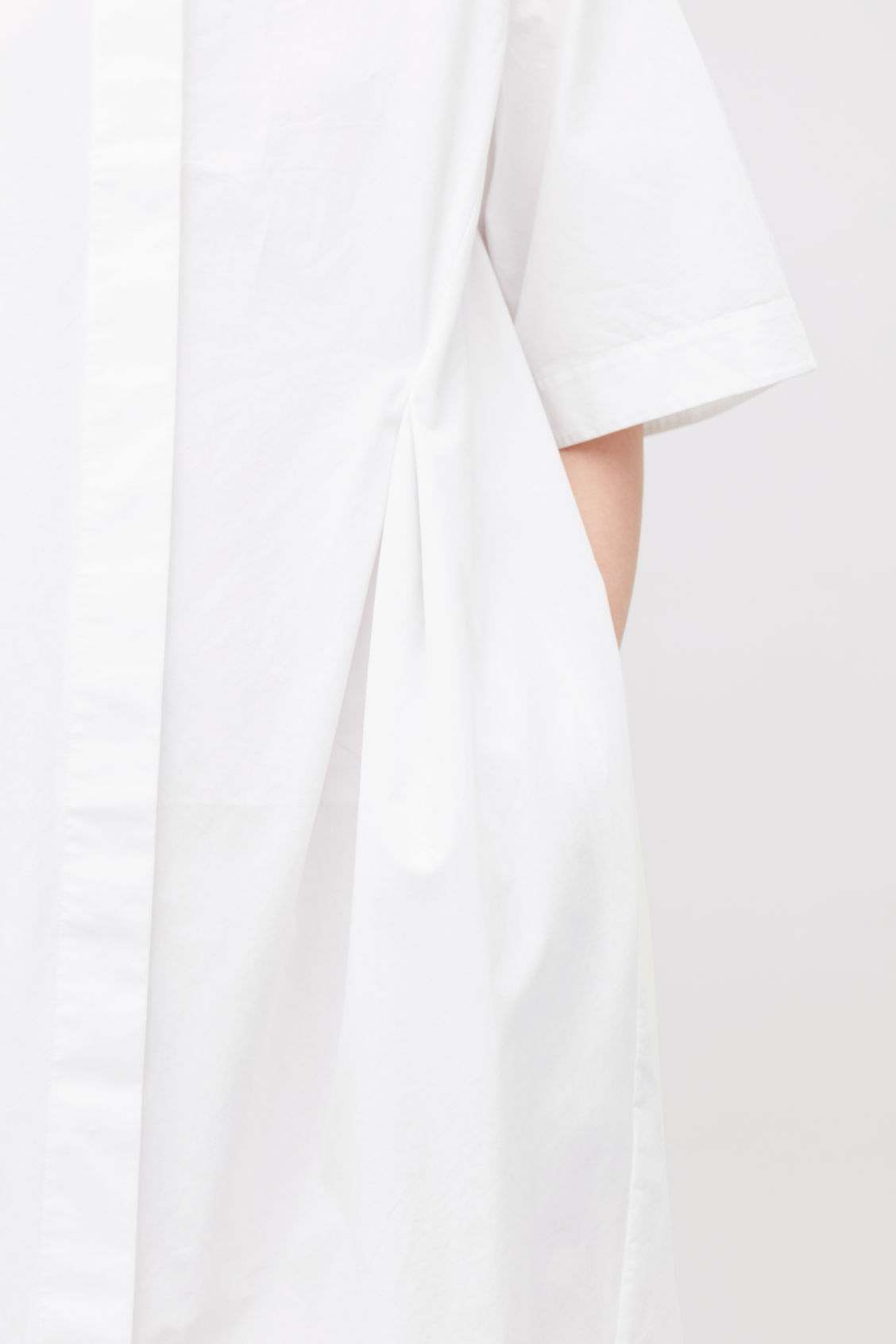 Model side image of Cos grandad shirt dress with darts in white