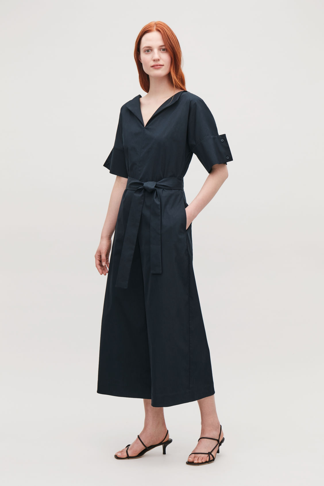 Model front image of Cos belted jumpsuit with sleeve detail in blue