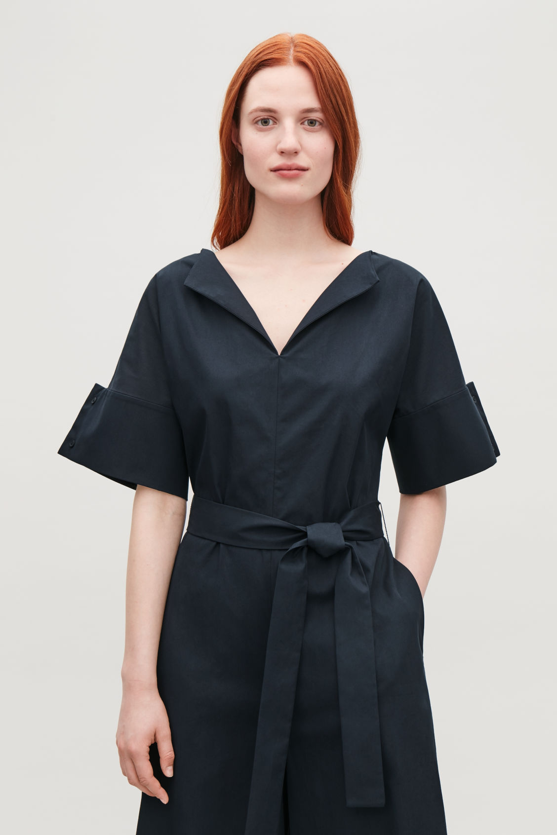 Model side image of Cos belted jumpsuit with sleeve detail in blue