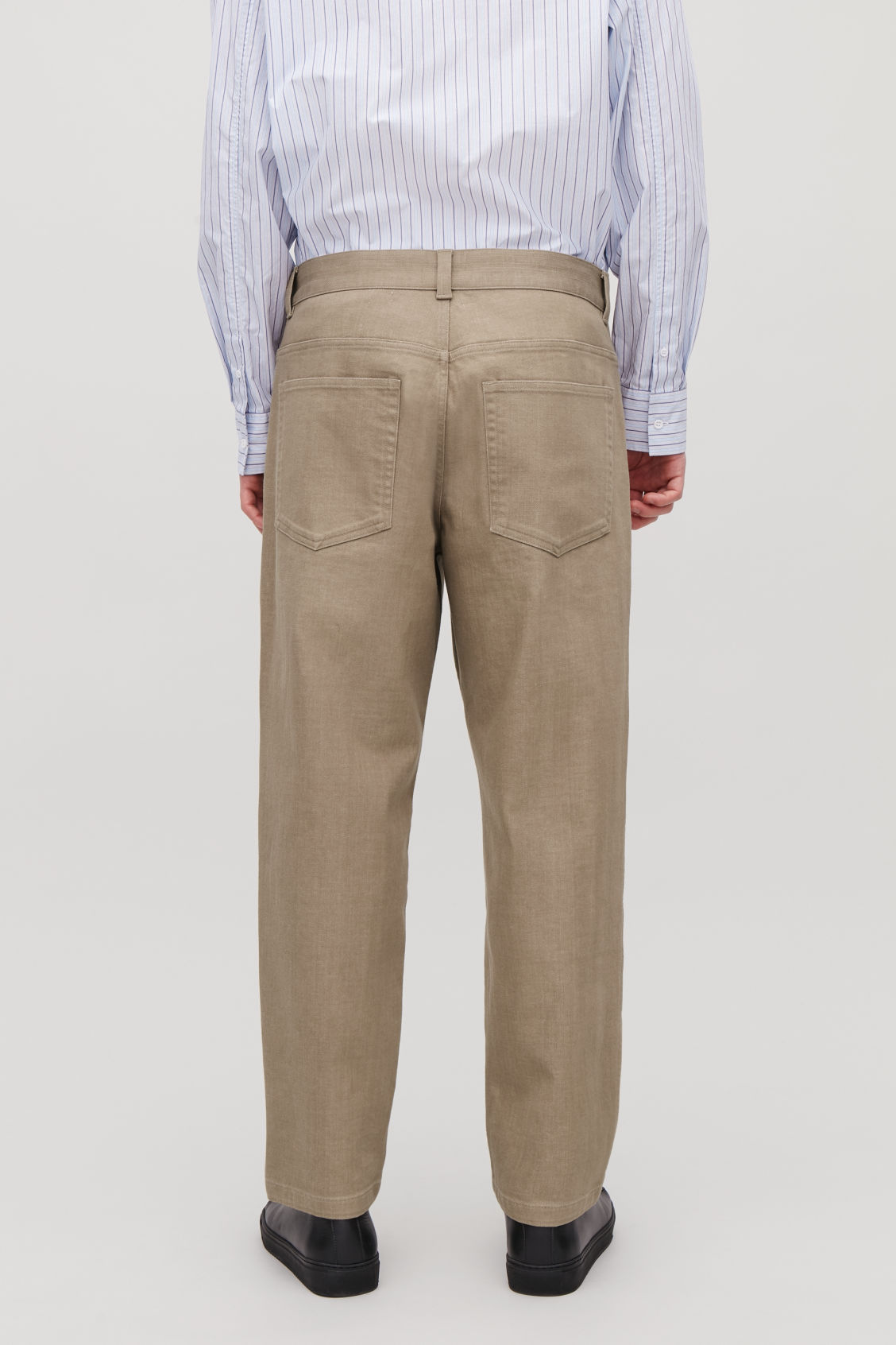 Model side image of Cos relaxed leg jeans in beige