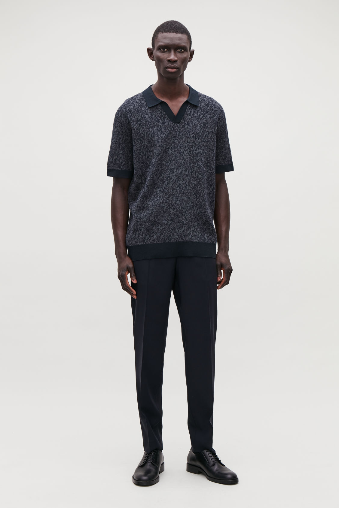 Model front image of Cos marble-print knit polo in grey