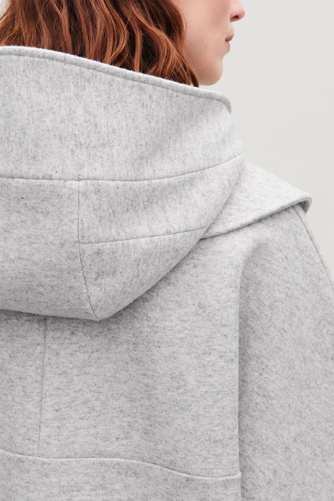 Model side image of Cos detachable-hood wool jacket in grey