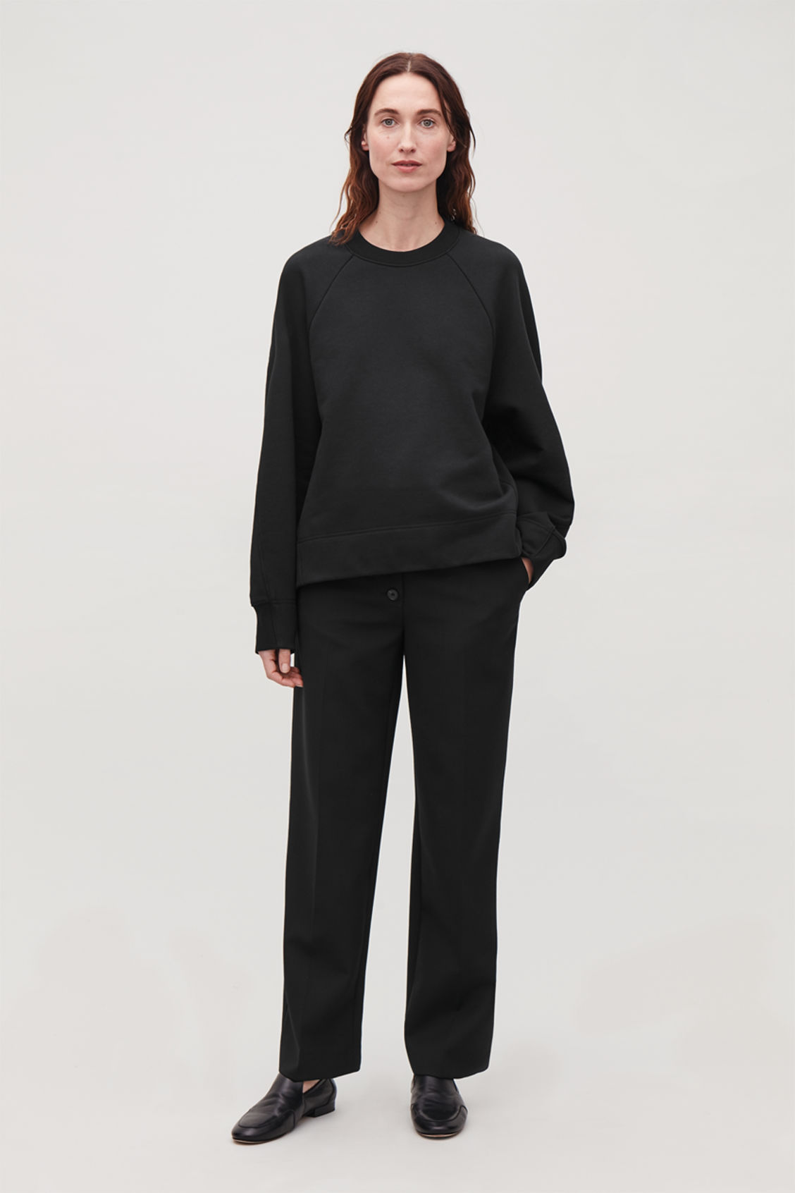 Model front image of Cos sweatshirt with shaped sleeves in black