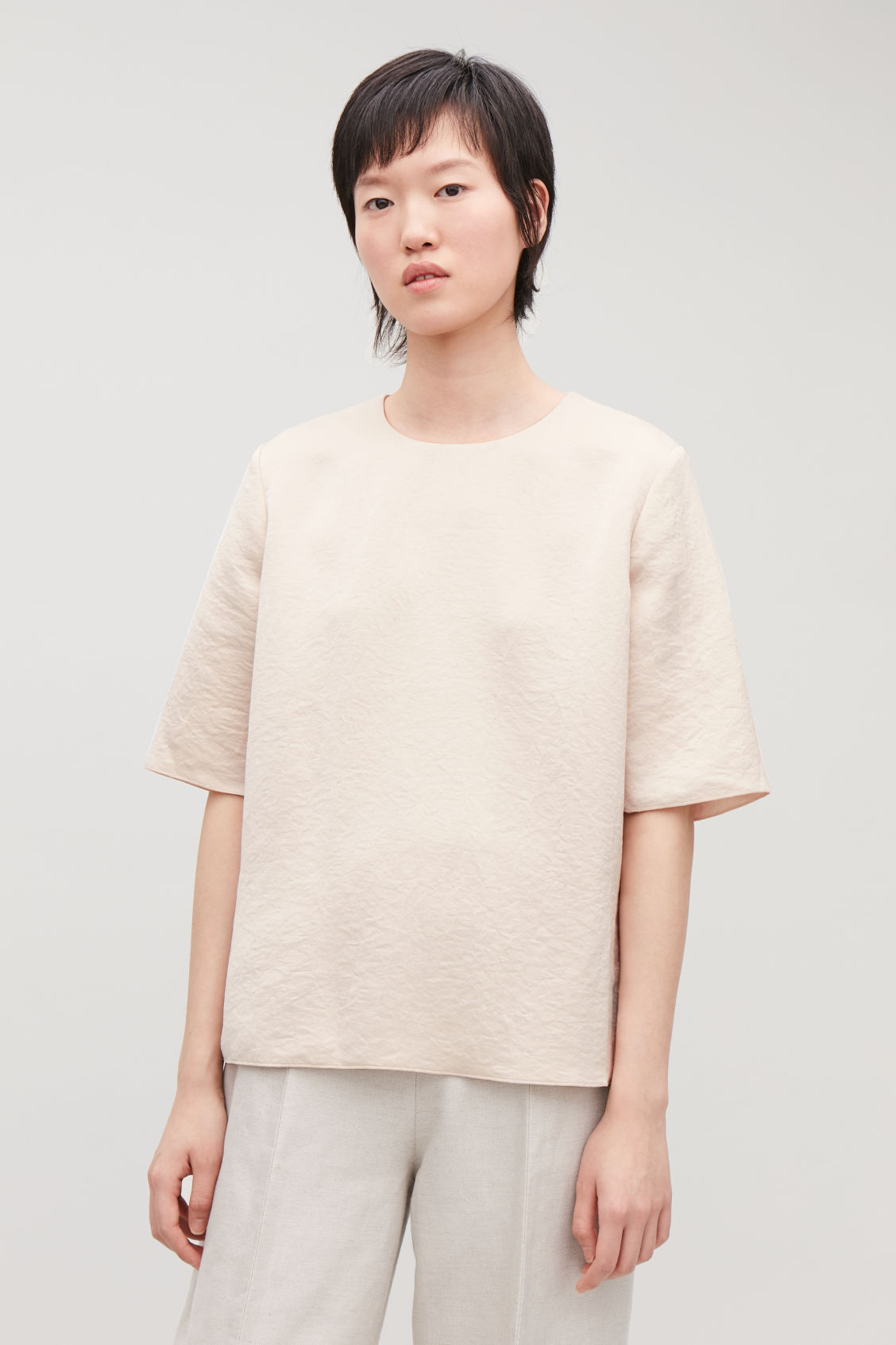 Model side image of Cos smooth boxy t-shirt in beige