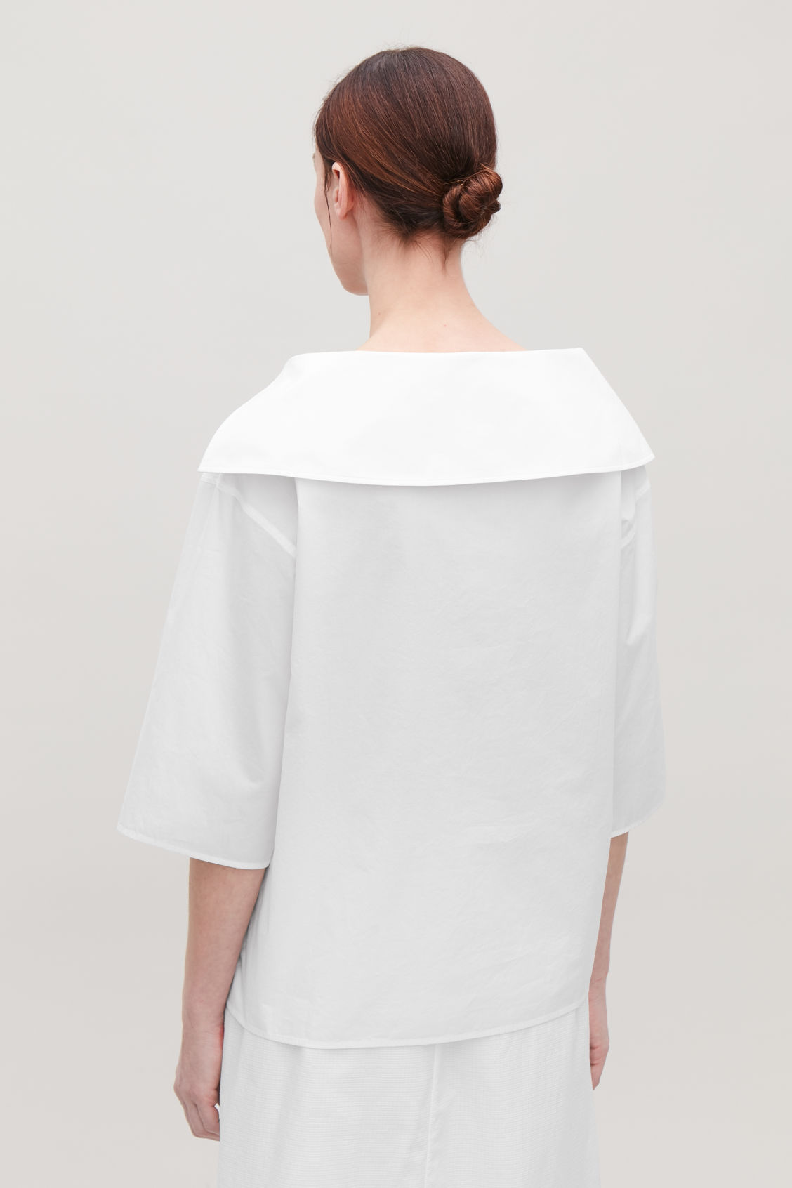 Model side image of Cos open-collar shirt in white
