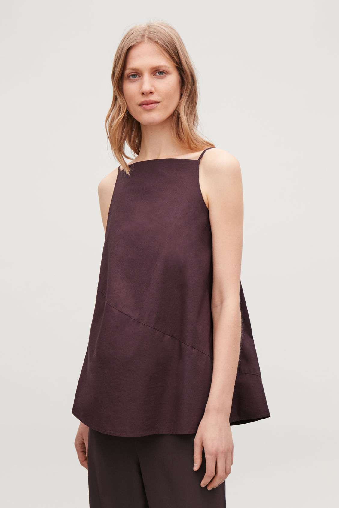 Model side image of Cos bias-cut sleeveless top in red