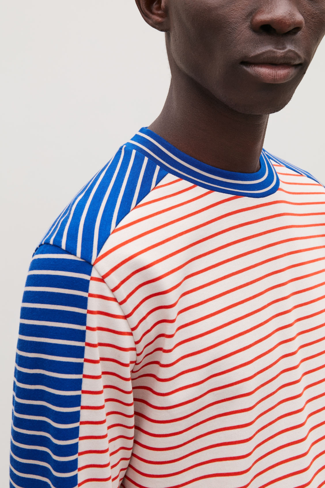 Model side image of Cos contrast stripe cotton top in blue