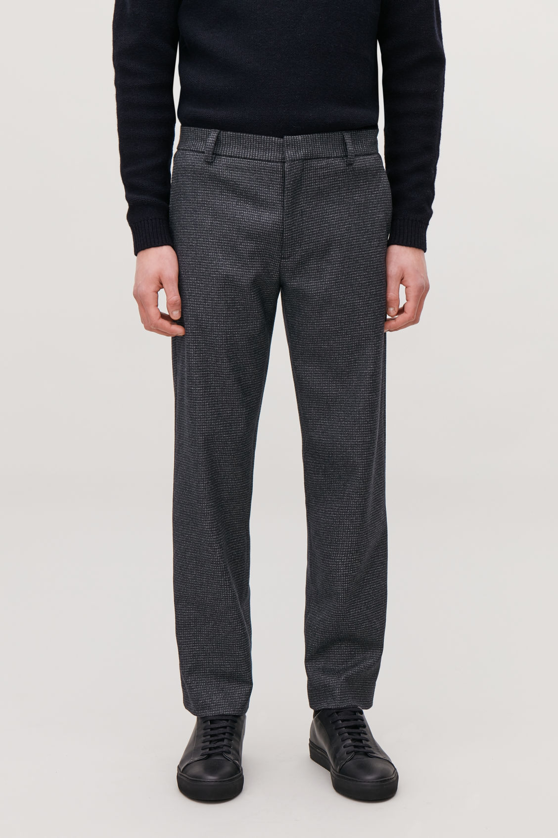 Model side image of Cos checked wool trousers in blue