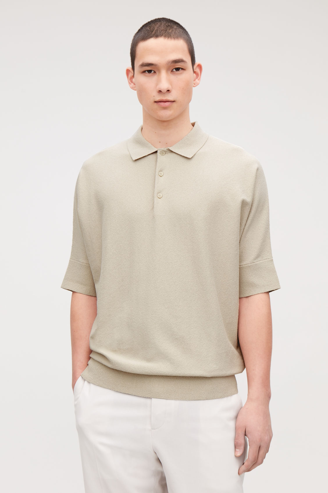 Model side image of Cos towelling-cotton polo shirt in beige