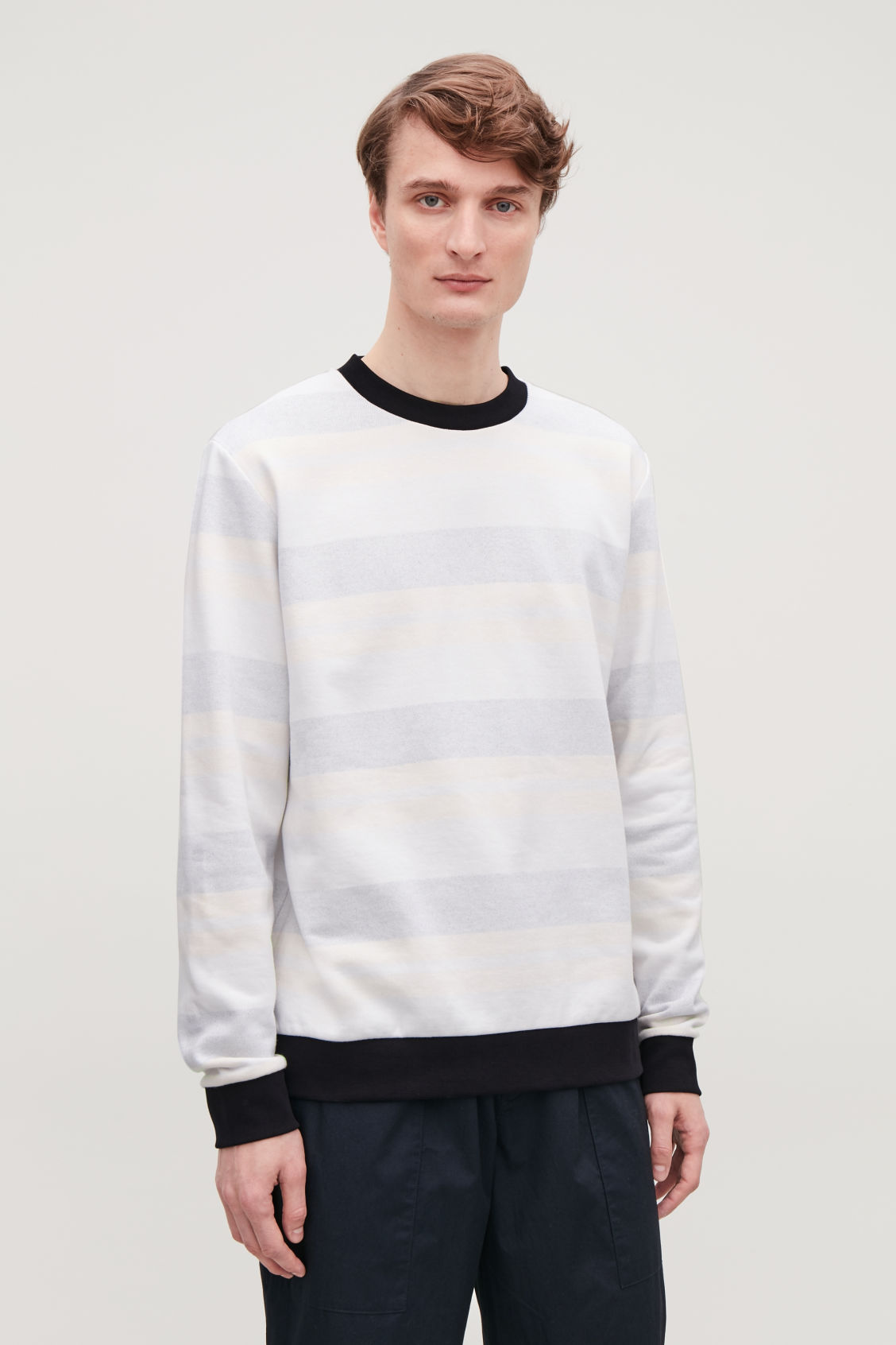 Model side image of Cos relaxed muted-stripe jumper in beige