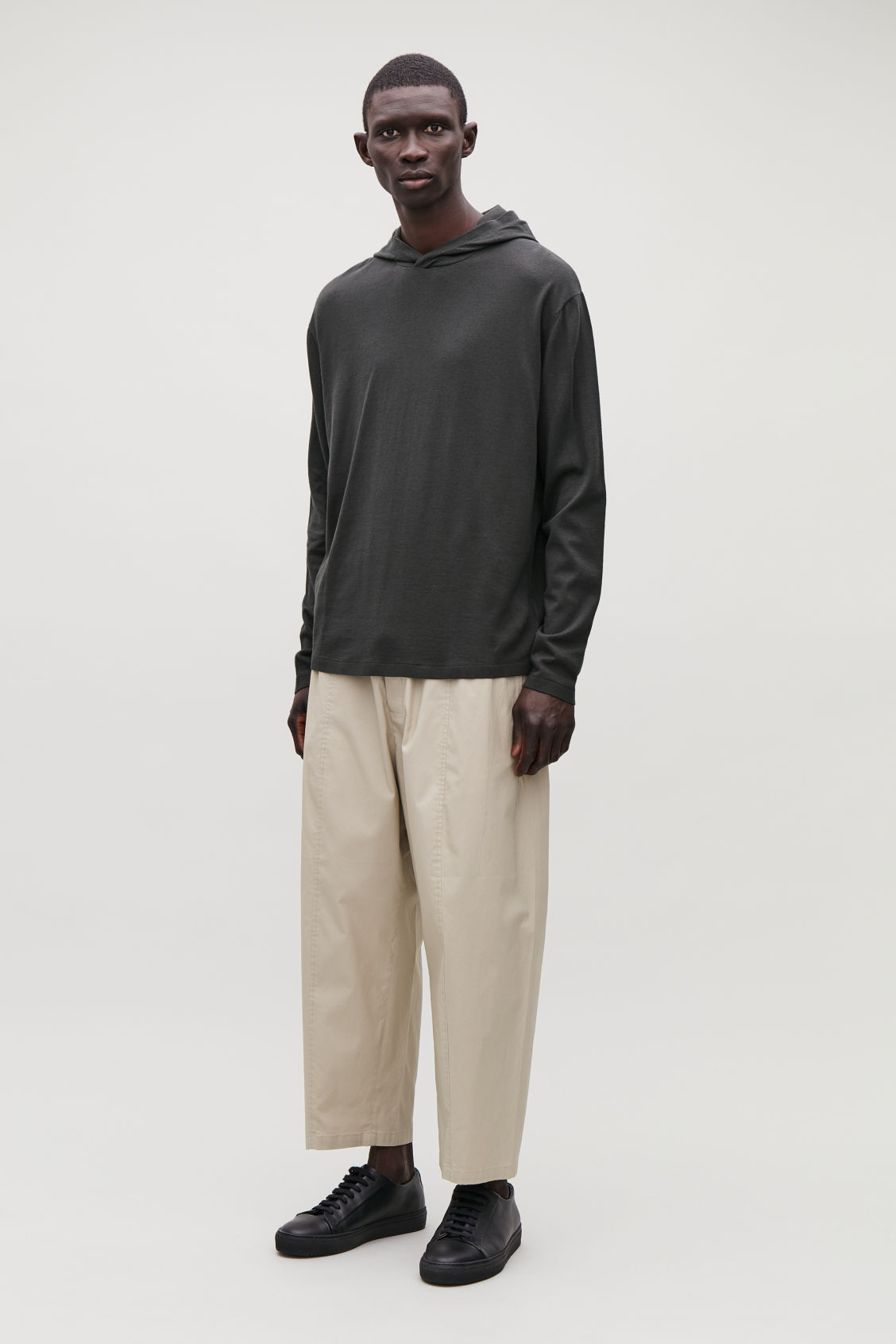Model front image of Cos hooded oversized sweater in beige