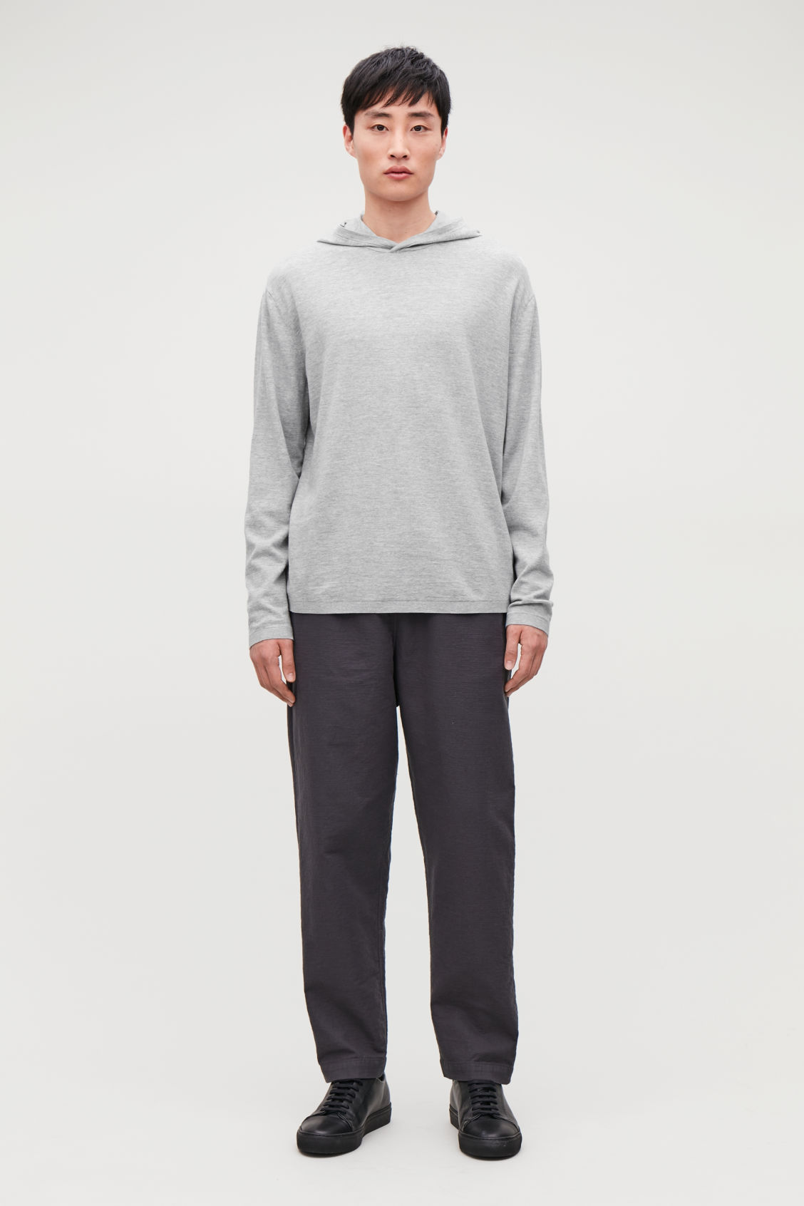 Model front image of Cos hooded oversized sweater in grey