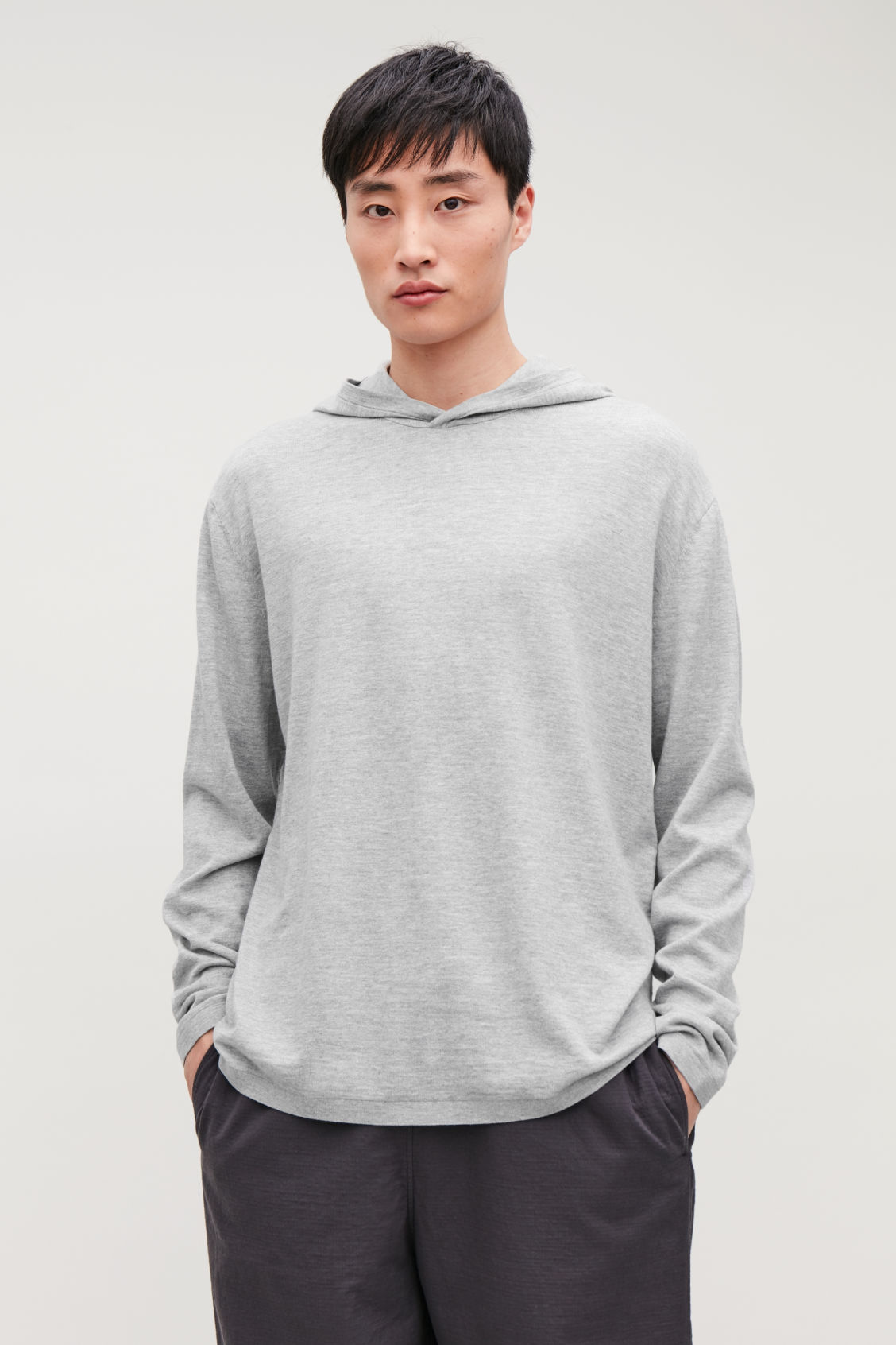 Model side image of Cos hooded oversized sweater in grey
