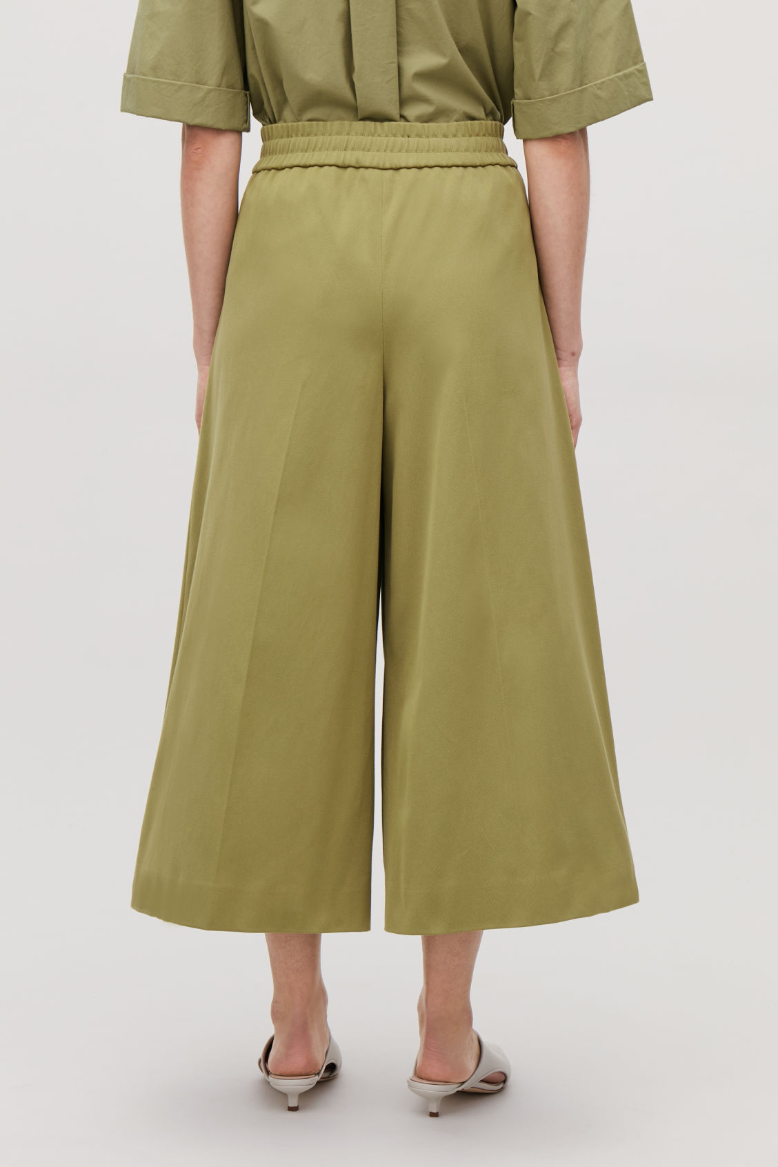 Model side image of Cos wide-leg drawstring trousers in green