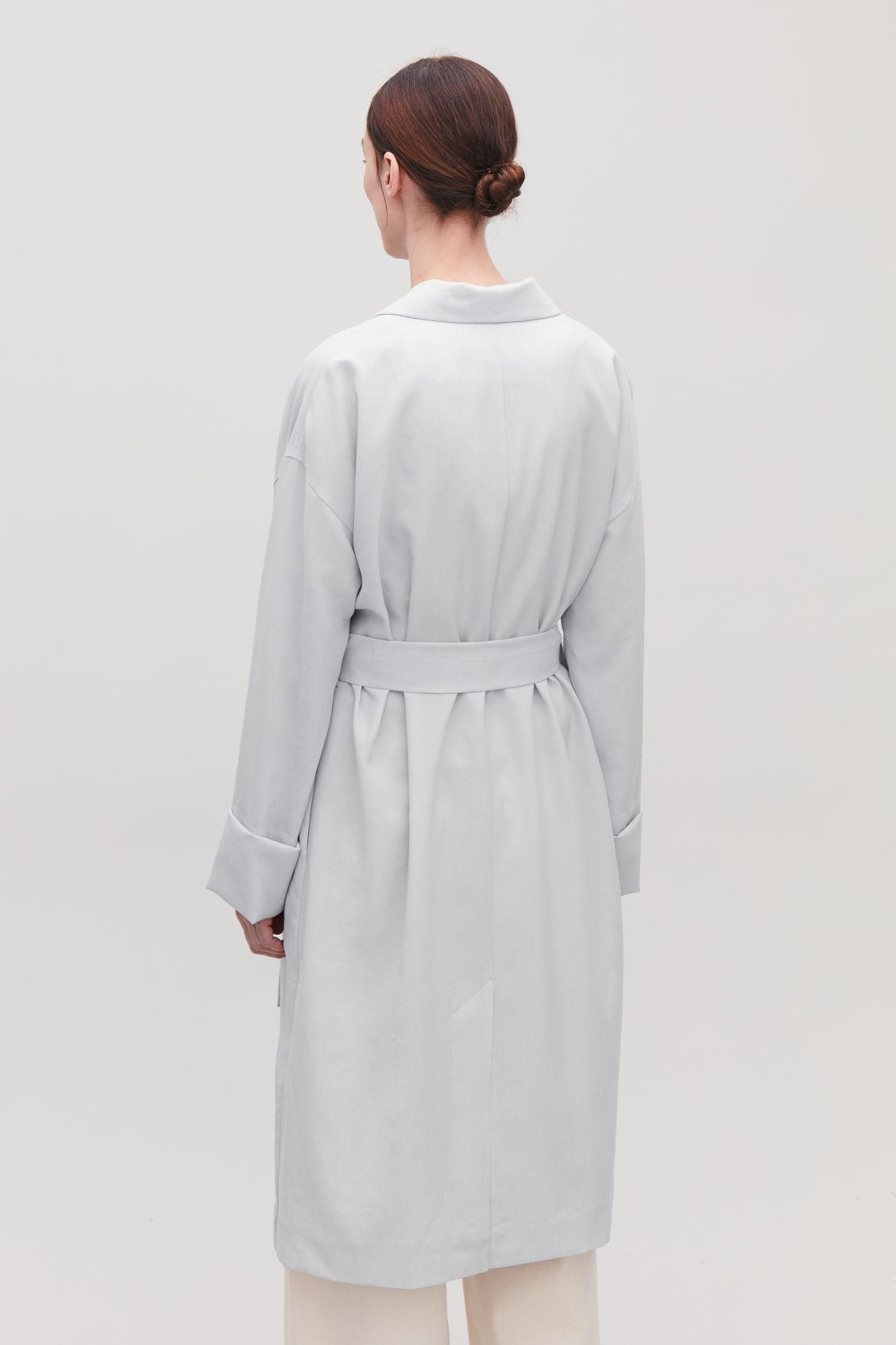 Model side image of Cos belted duster coat in grey