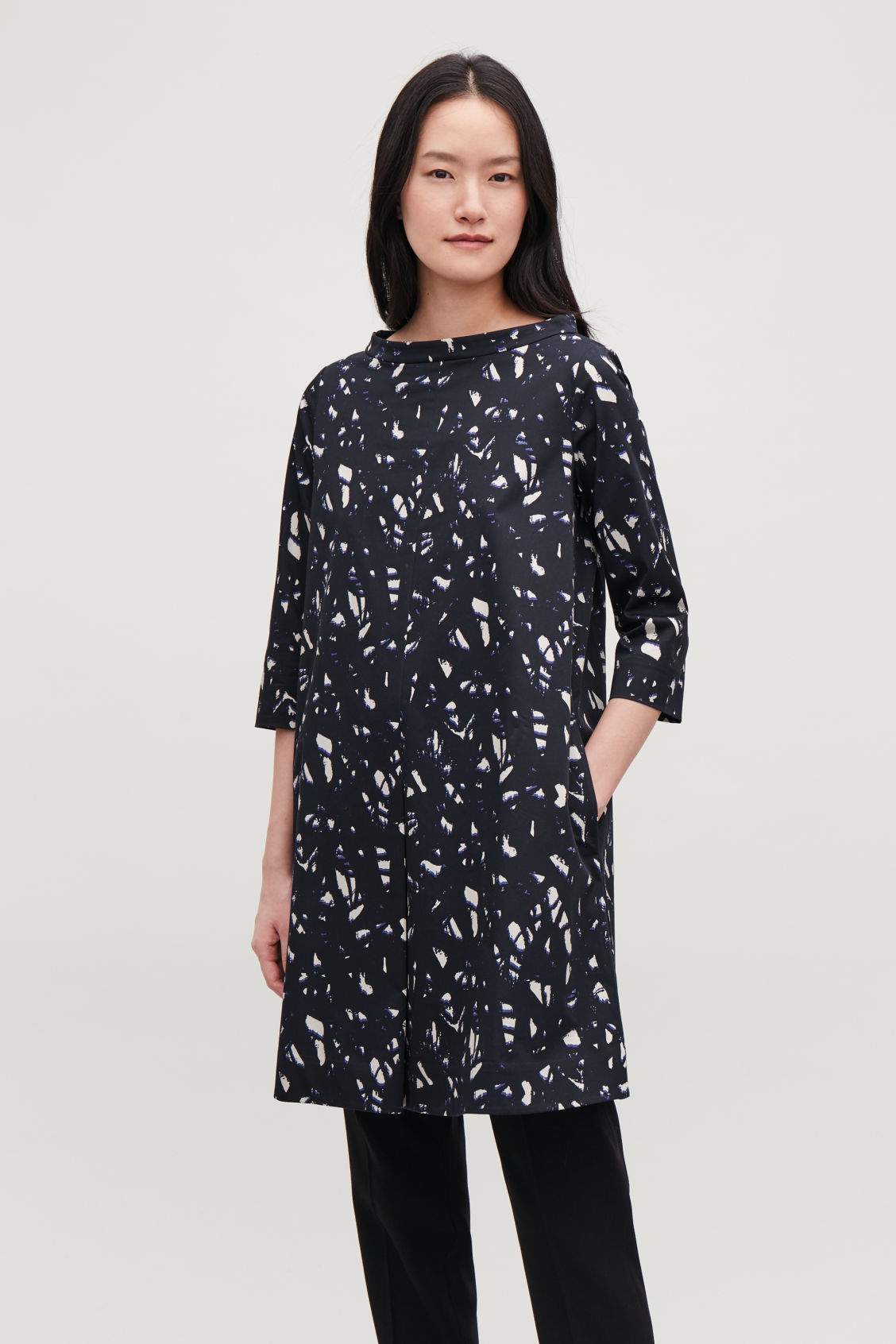 Model side image of Cos printed raised-collar dress in black