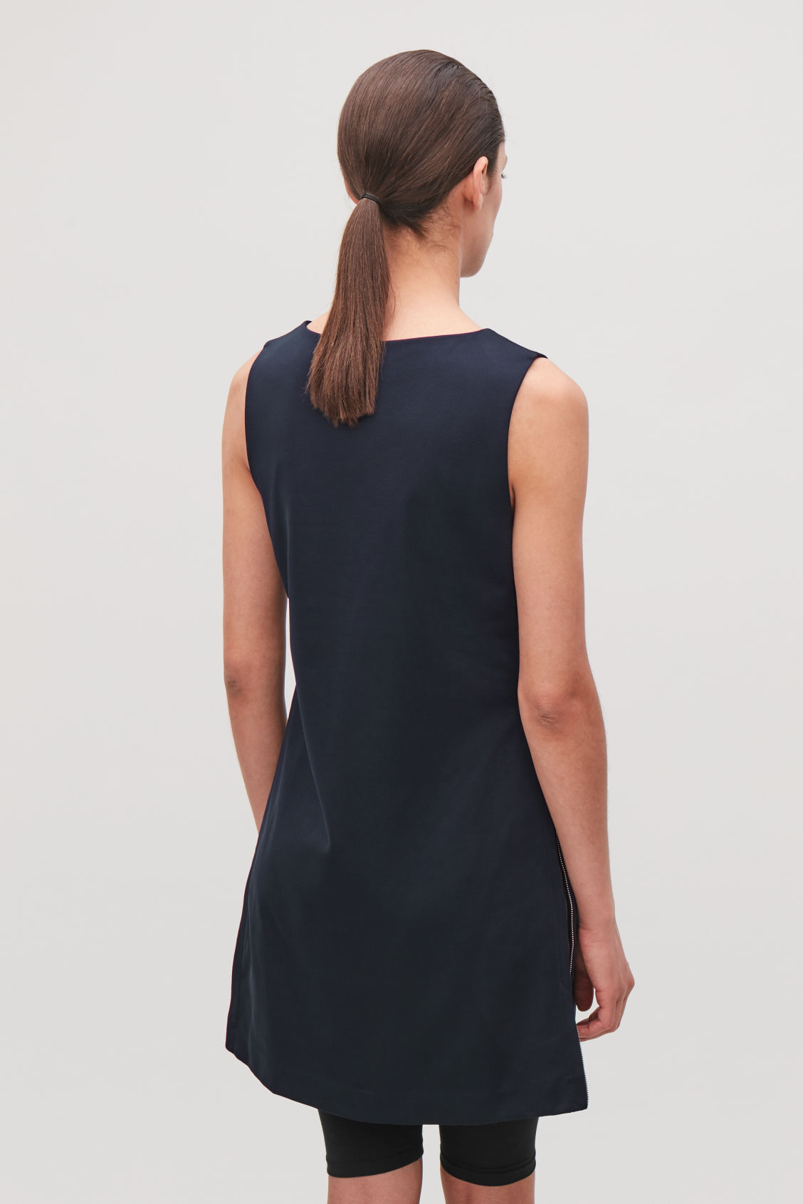 Model side image of Cos organic-cotton tunic dress in blue