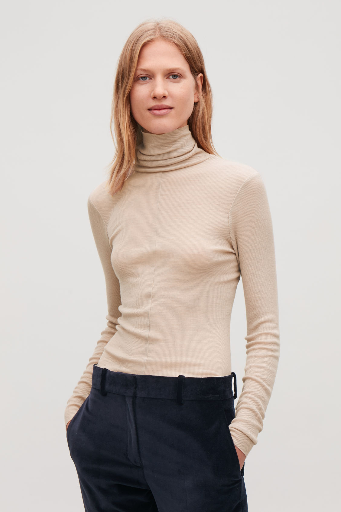 Model side image of Cos ribbed jersey high-neck top in pink